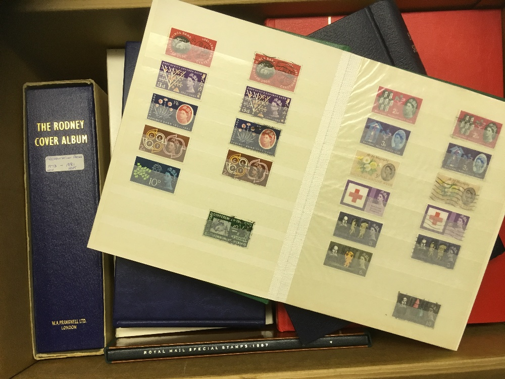 Lot 36 - STAMPS : World accumulation of stamps and GB first day covers and presentation packs in 13 albums