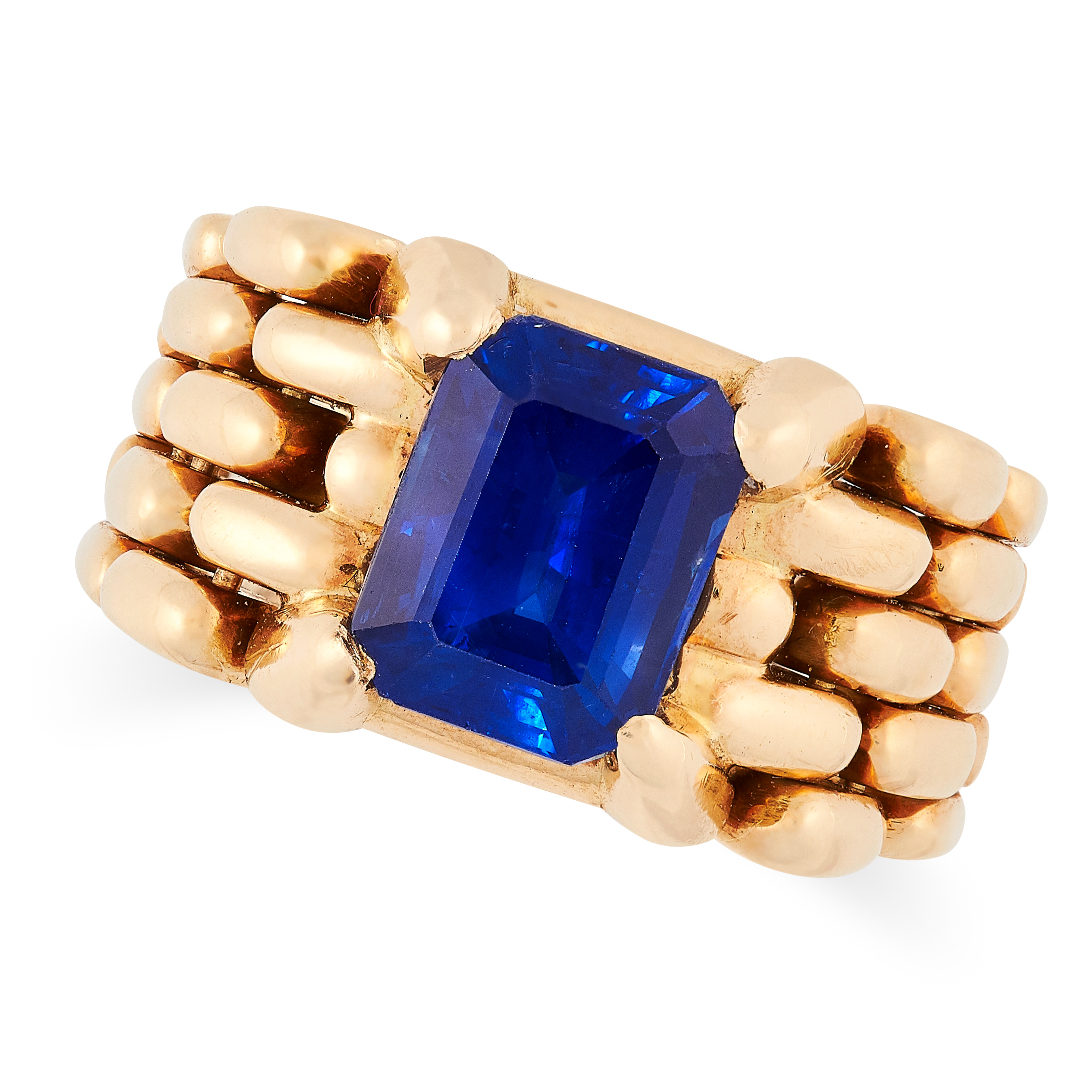 A VINTAGE SAPPHIRE RING comprising of an emerald cut sapphire of 4.70 carats in an articulated