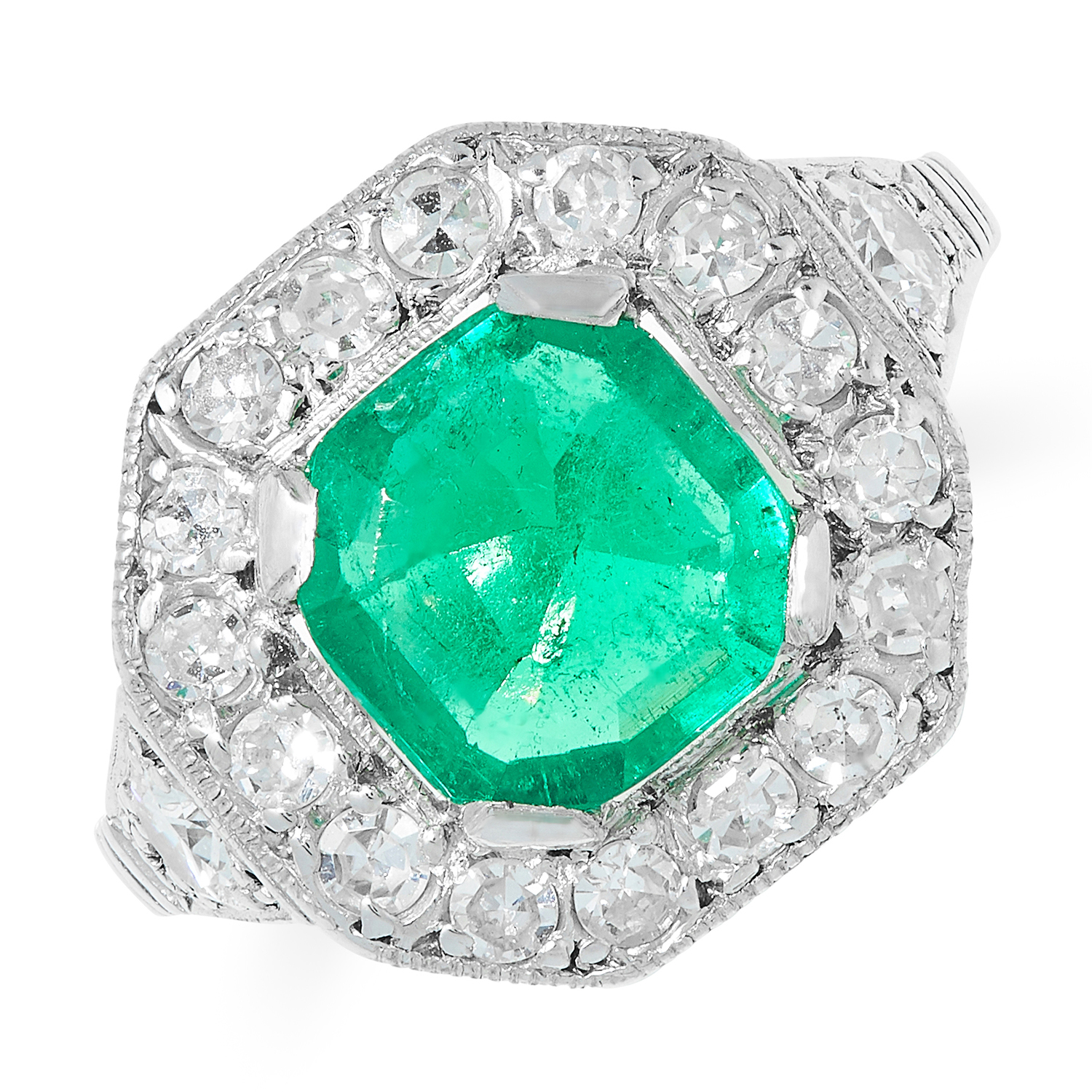 AN ART DECO COLOMBIAN EMERALD AND DIAMOND RING set with an emerald cut emerald of 1.42 carats within