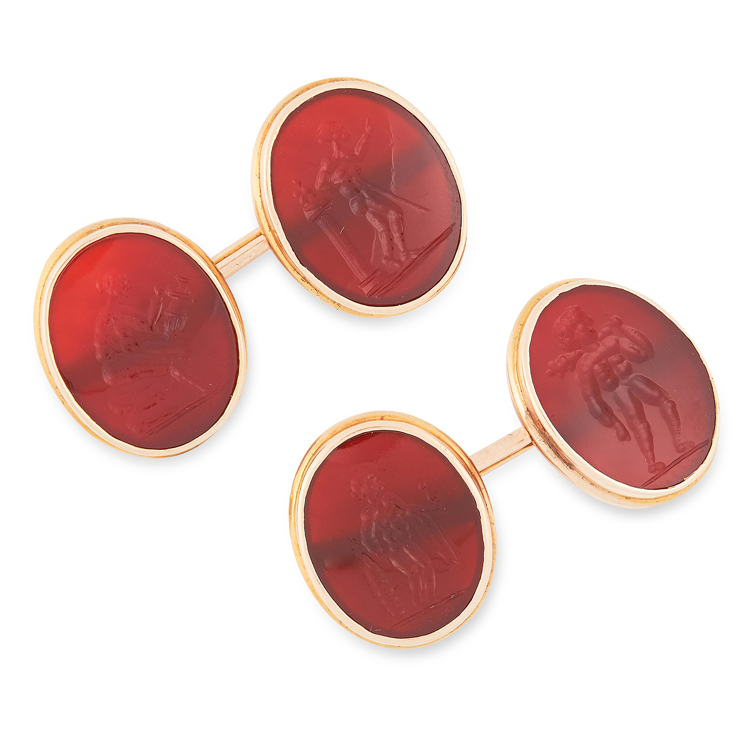 A PAIR OF ANTIQUE CARVED INTAGLIO SEAL CUFFLINKS set with oval carnelian panels reverse carved to
