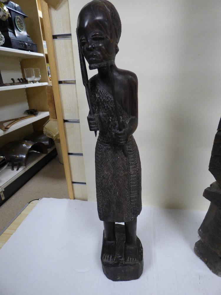 Lot 335 - A PAIR OF AFRICAN CARVED HARDWOOD FIGURES, 49CM HIGH, TOGETHER WITH A SIMILAR CORNER POST 90CM HIGH