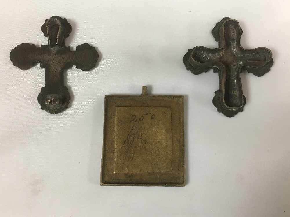 Lot 184 - THREE EARLY BRONZE ICONS, TWO DEPICTING JESUS UPON THE CROSS, THE OTHER MARY WITH CHILD, LARGEST 6.