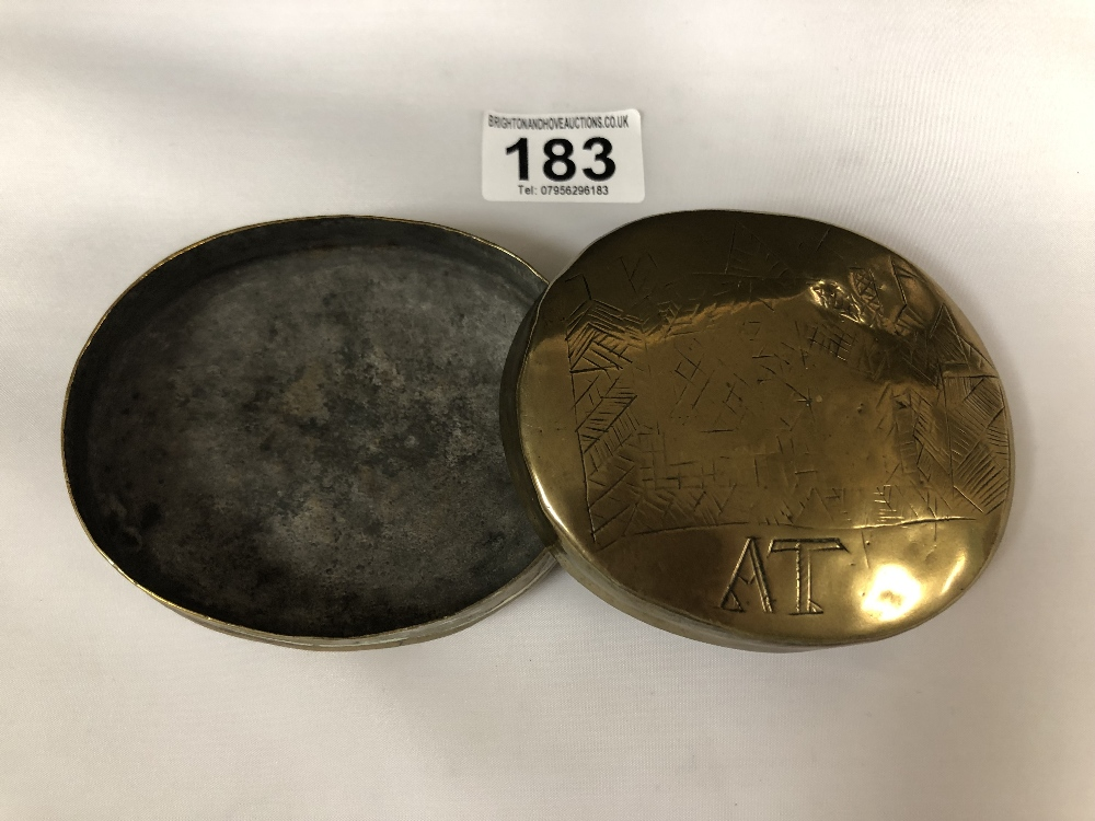 Lot 183 - AN 18TH CENTURY BRASS TOBACCO/SNUFF BOX OF OVAL FORM WITH SCRATCH DECORATION ON BOTH SIDES AND DATED