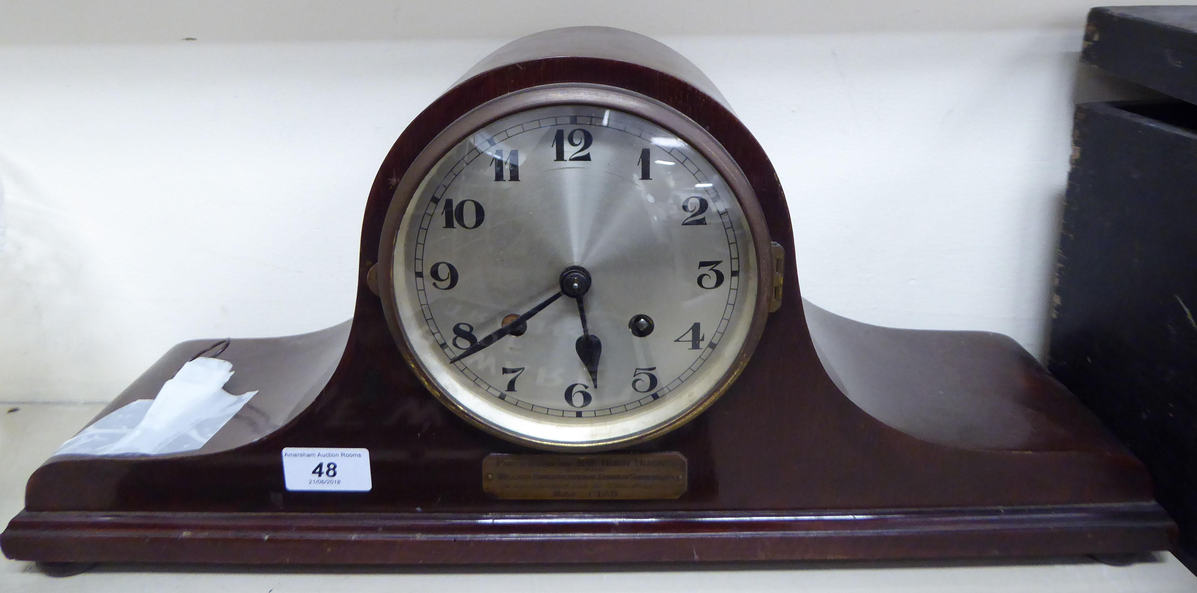 Lot 48 - A 1920s mahogany cased Napoleon's hat shaped mantel clock;