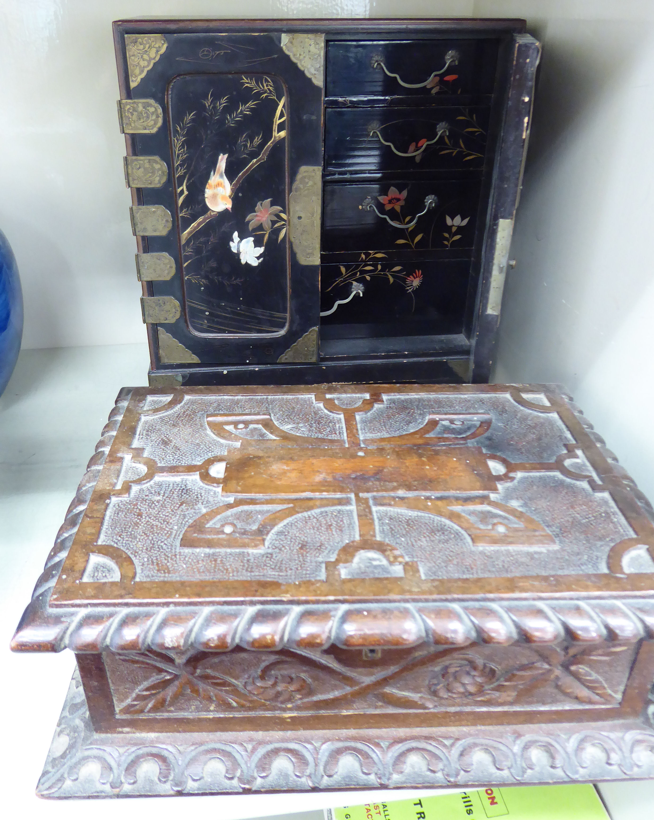 Lot 8 - An early 20thC Japanese black lacquered and inlaid table cabinet,