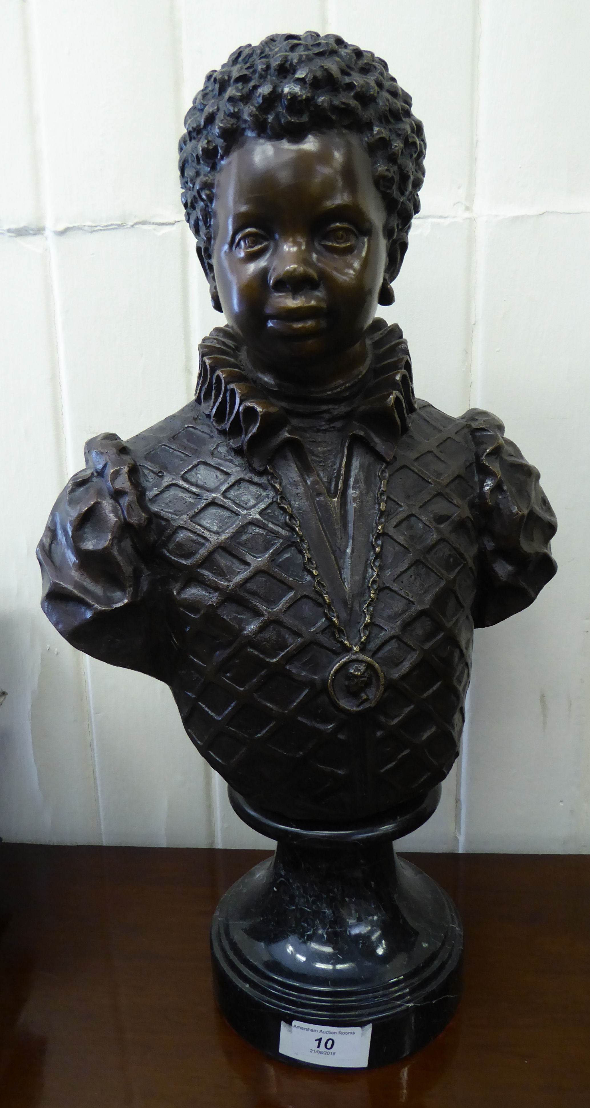 Lot 10 - A cast and patinated bronze bust, a boy,