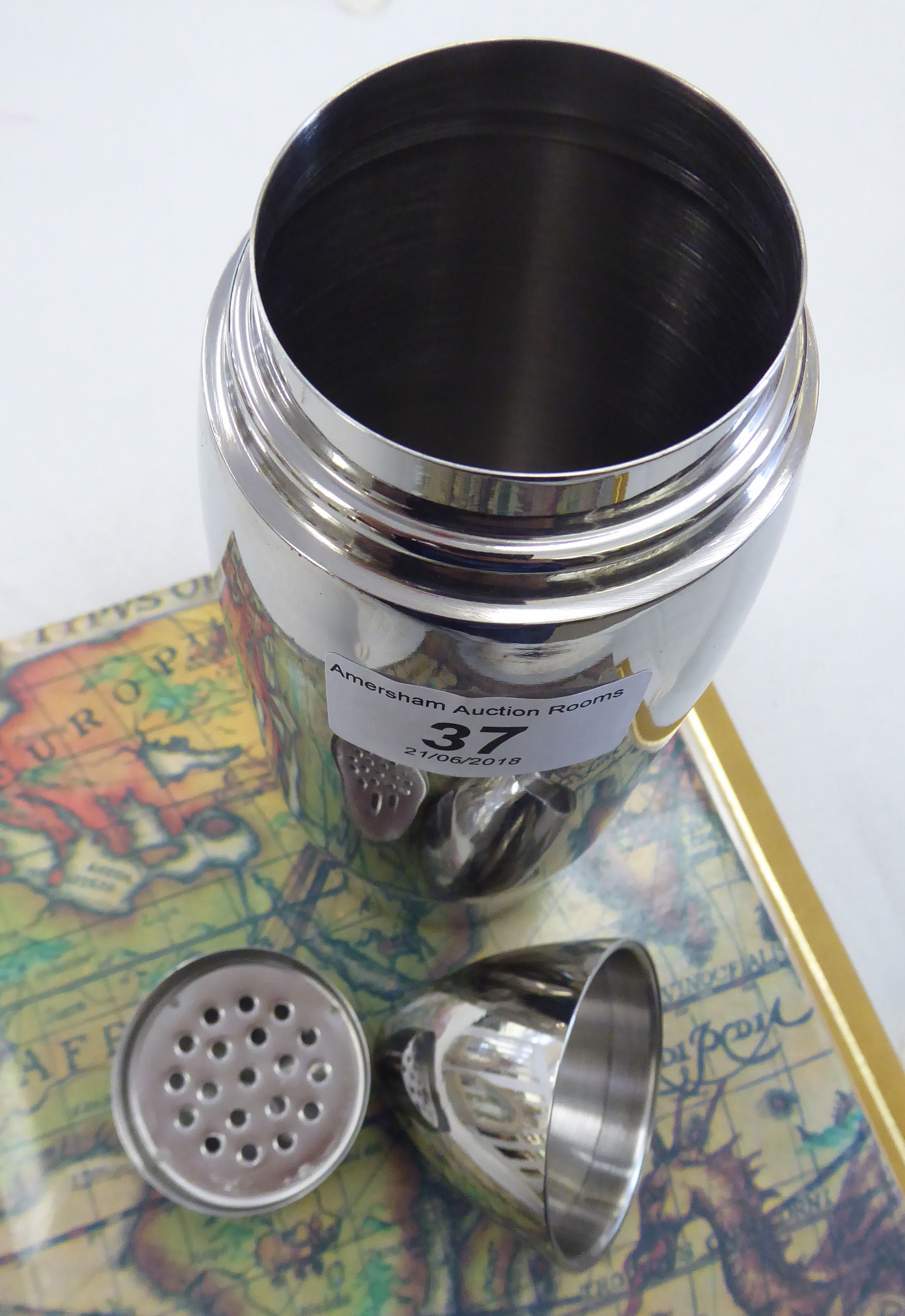 Lot 37 - A novelty stainless steel cocktail shaker,
