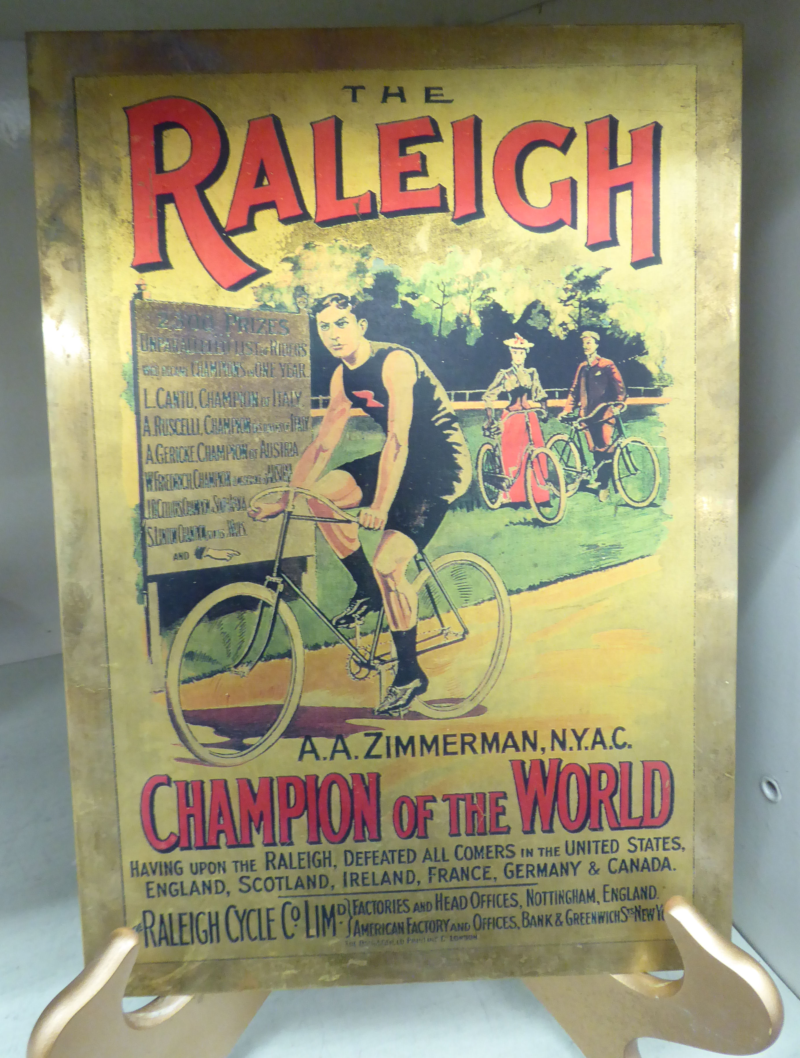 Lot 22 - A reproduction of an earlier printed brass advertising sign 'The Raleigh' 8'' x 11'' CA