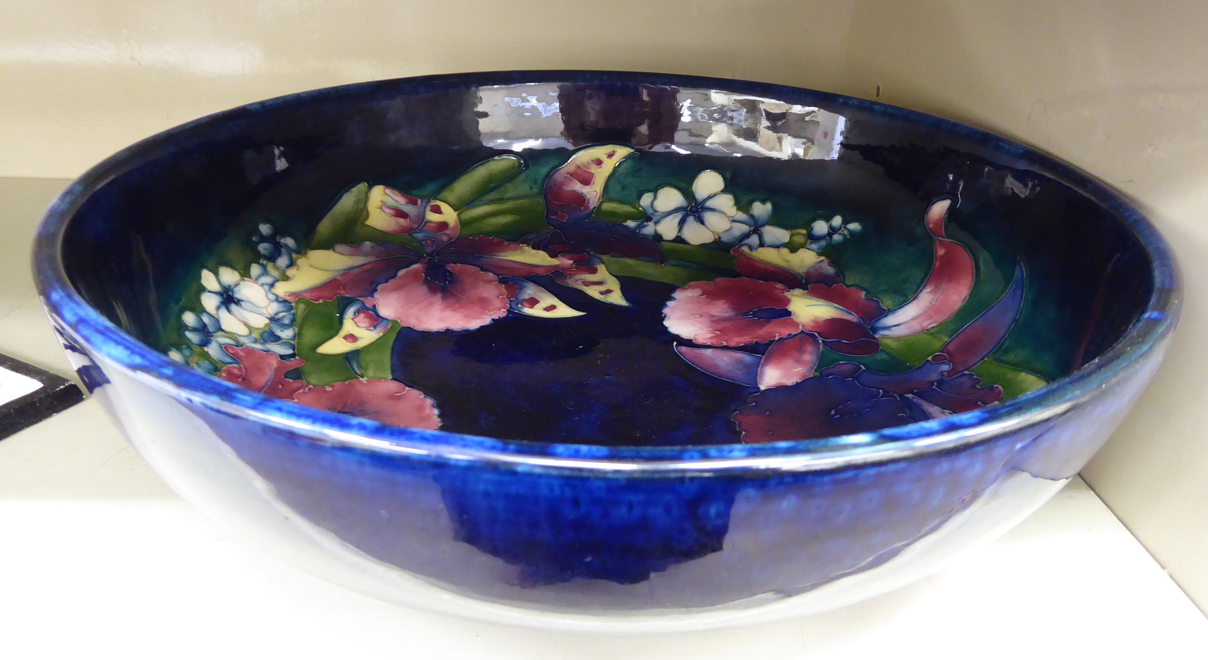 Lot 19 - A 1930s Moorcroft pottery shallow fruit bowl bears painted & impressed marks 12.