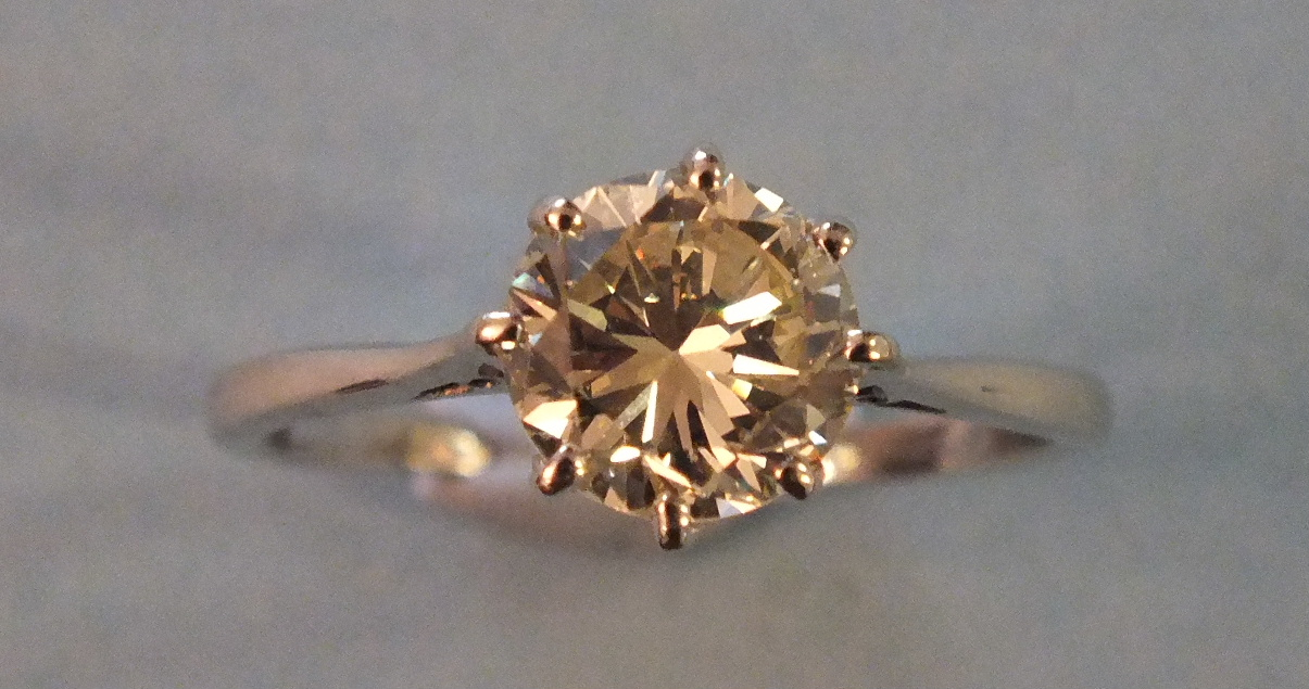Lot 214 - A certificated solitaire diamond ring claw set a brilliant cut diamond of 1.71cts in 18ct gold and