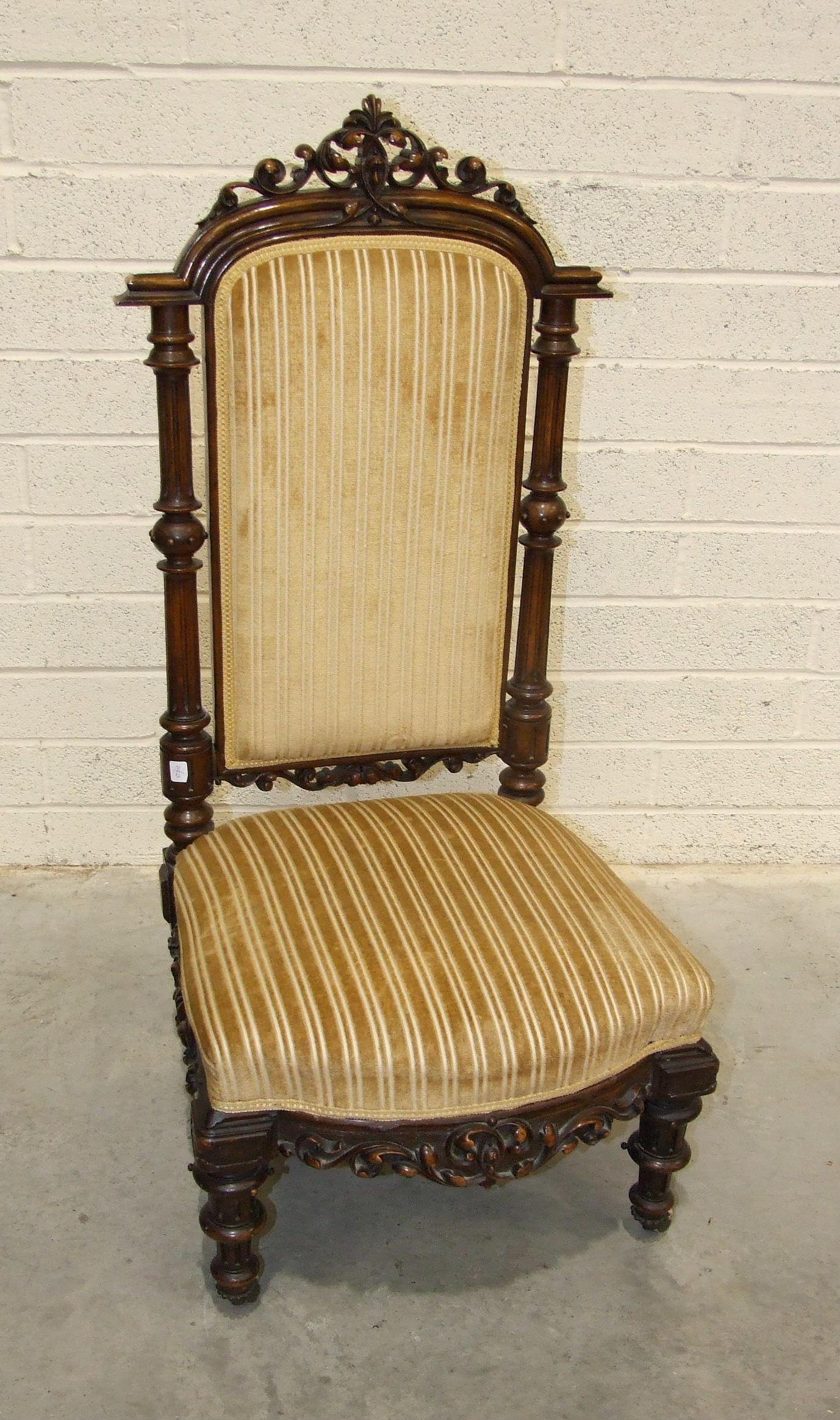 Lot 66 - A Victorian walnut carved high-back nursing chair on turned feet, 112cm high.