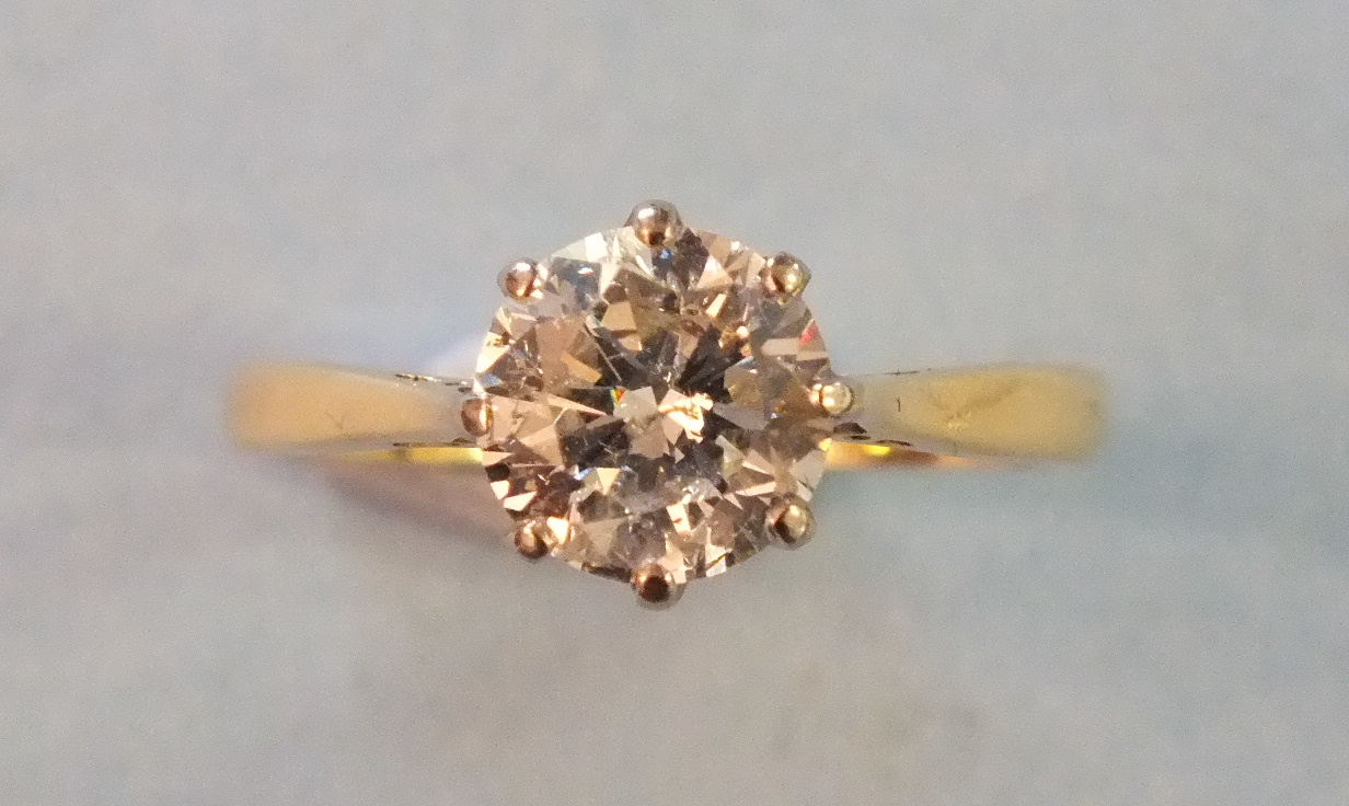 Lot 190 - A solitaire diamond ring claw-set a brilliant-cut diamond of approximately 1.2cts, in 18ct yellow