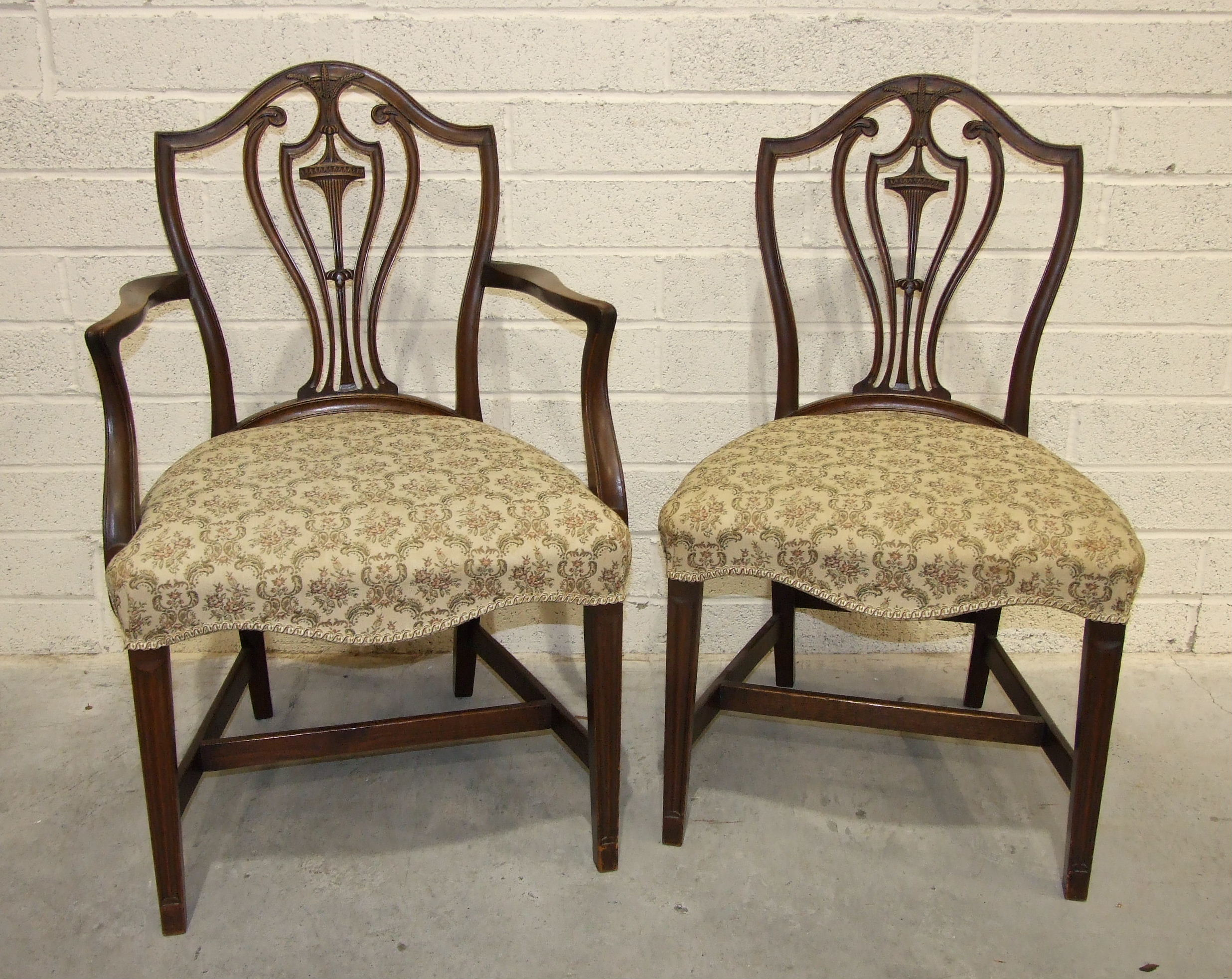 Lot 64 - A set of six Adam-style dining chairs with serpentine upholstered seats, on moulded tapered legs and