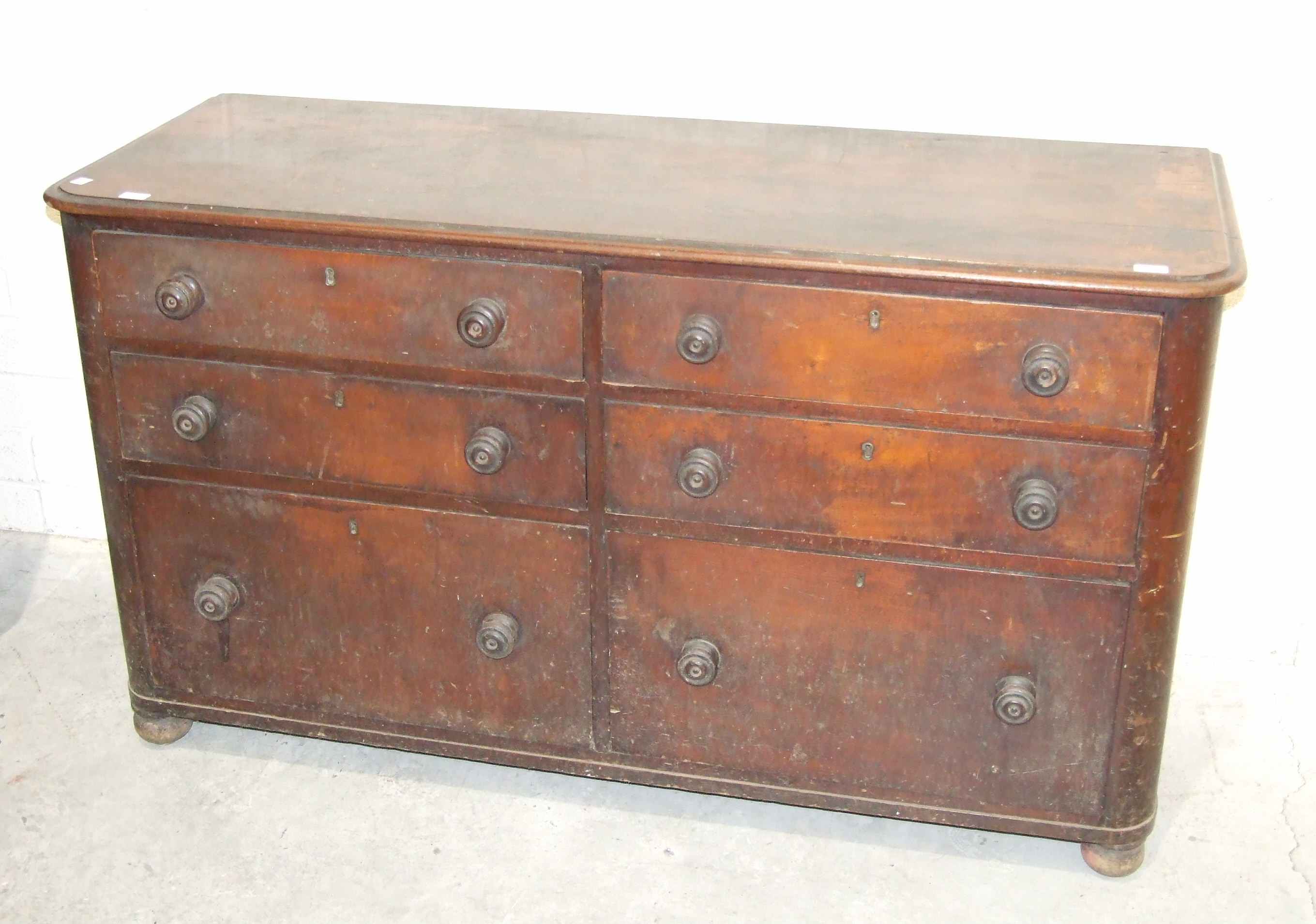 Lot 70 - An early 19th century mahogany storage chest of six graduated drawers in two banks with turned