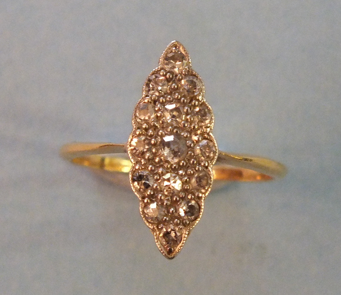 Lot 193 - An Edwardian diamond marquise cluster ring set fifteen 8/8 cut diamonds in yellow and white 18ct