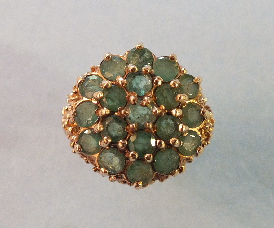 Lot 217 - An emerald cluster ring, claw set nineteen round cut emeralds in 9ct gold mount, size J, 5.5g.