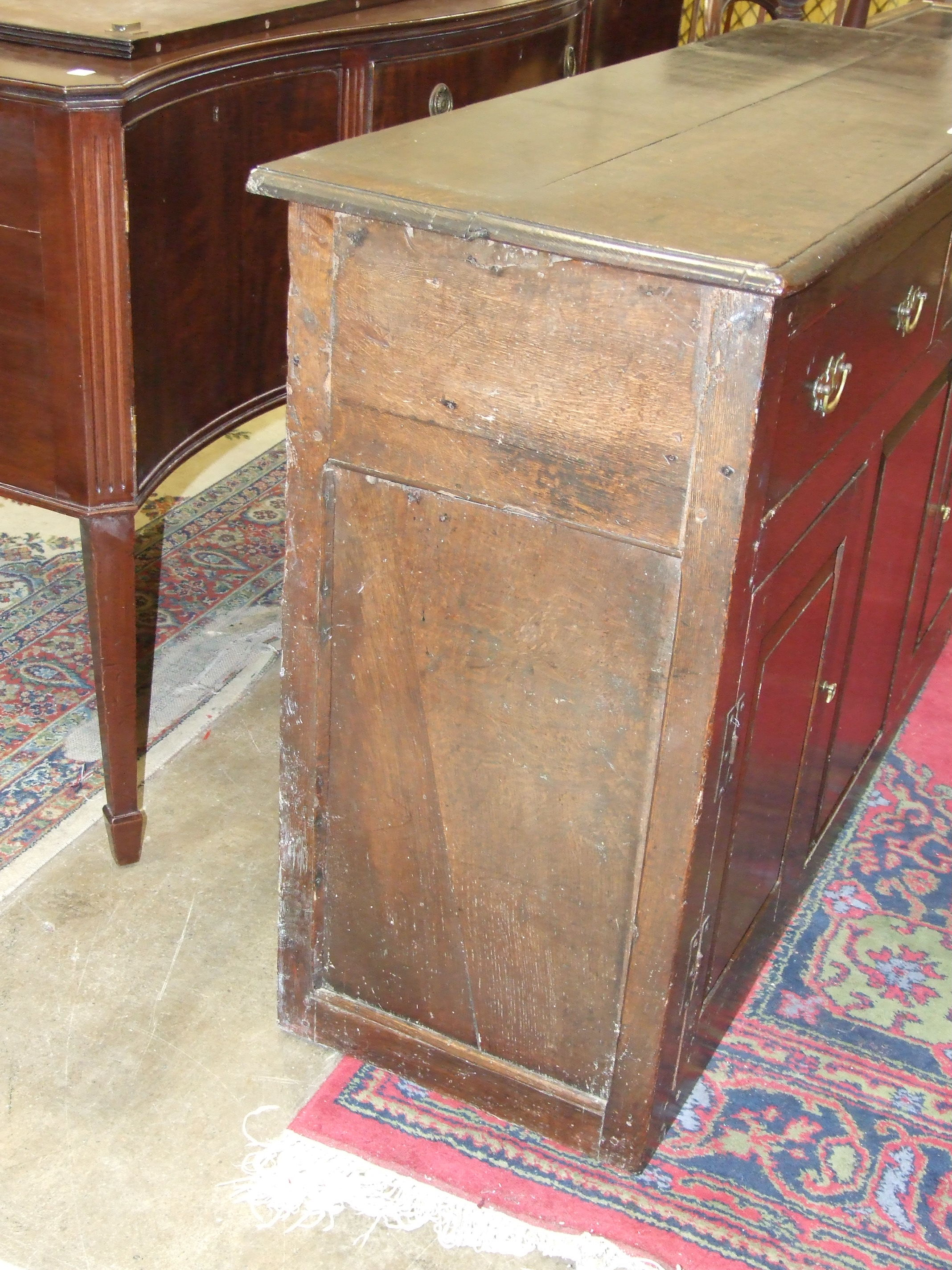 Lot 77 - An 18th century oak dresser base, the rectangular top above two frieze drawers, a pair of fielded