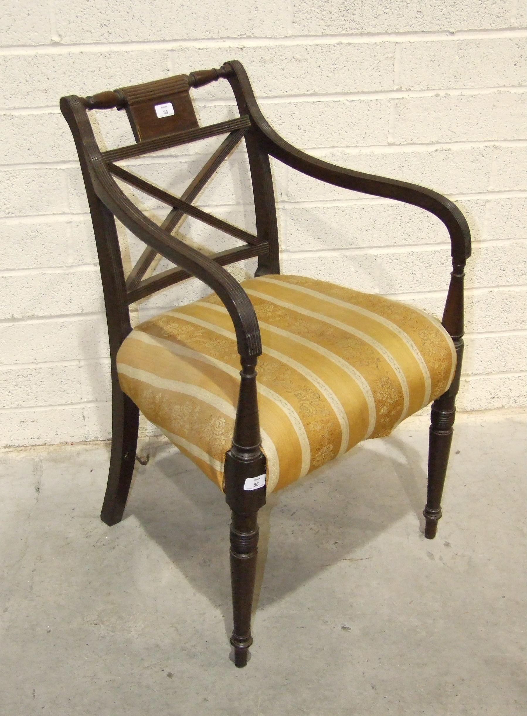 Lot 56 - A late-Georgian mahogany carver chair with reeded frame and upholstered seat, on turned legs.