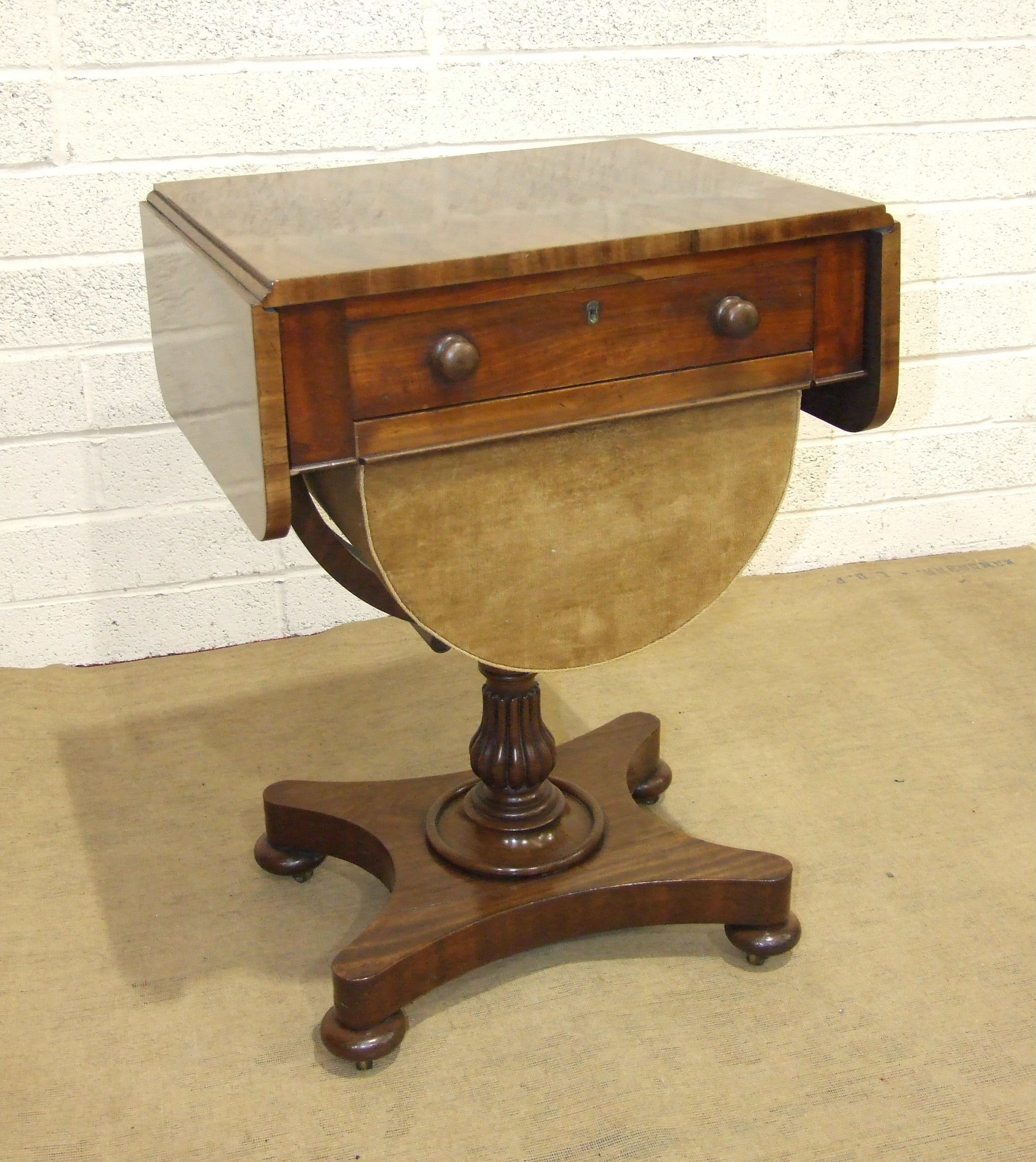 Lot 52 - A William IV mahogany work table, the rectangular top with two drop leaves above a drawer and half-