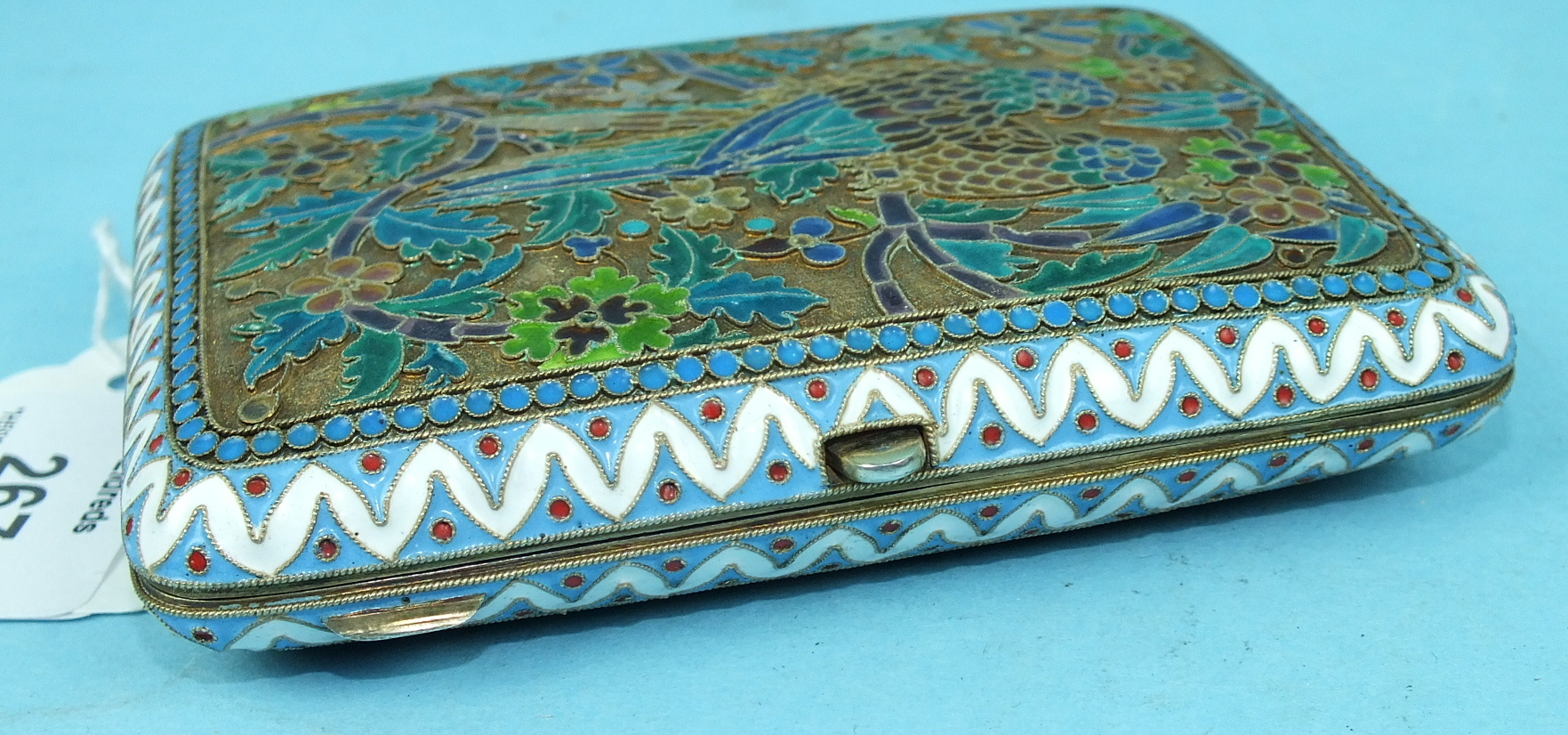Lot 267 - A Russian silver gilt and plique-à-jour enamel cigarette case, each hinged side decorated with a