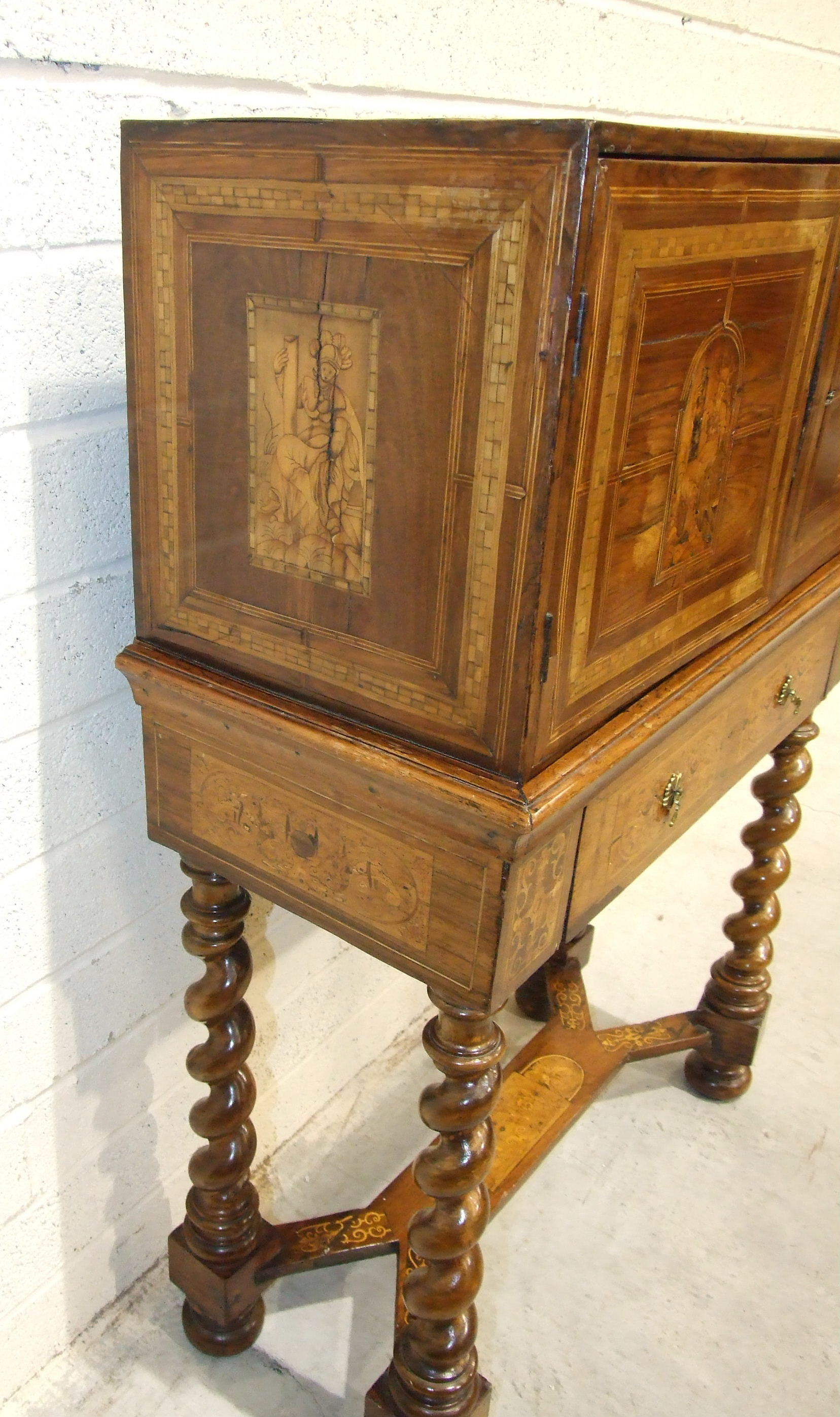 Lot 61 - A mainly 18th-century-style Continental table cabinet with overall marquetry and parquetry inlay,