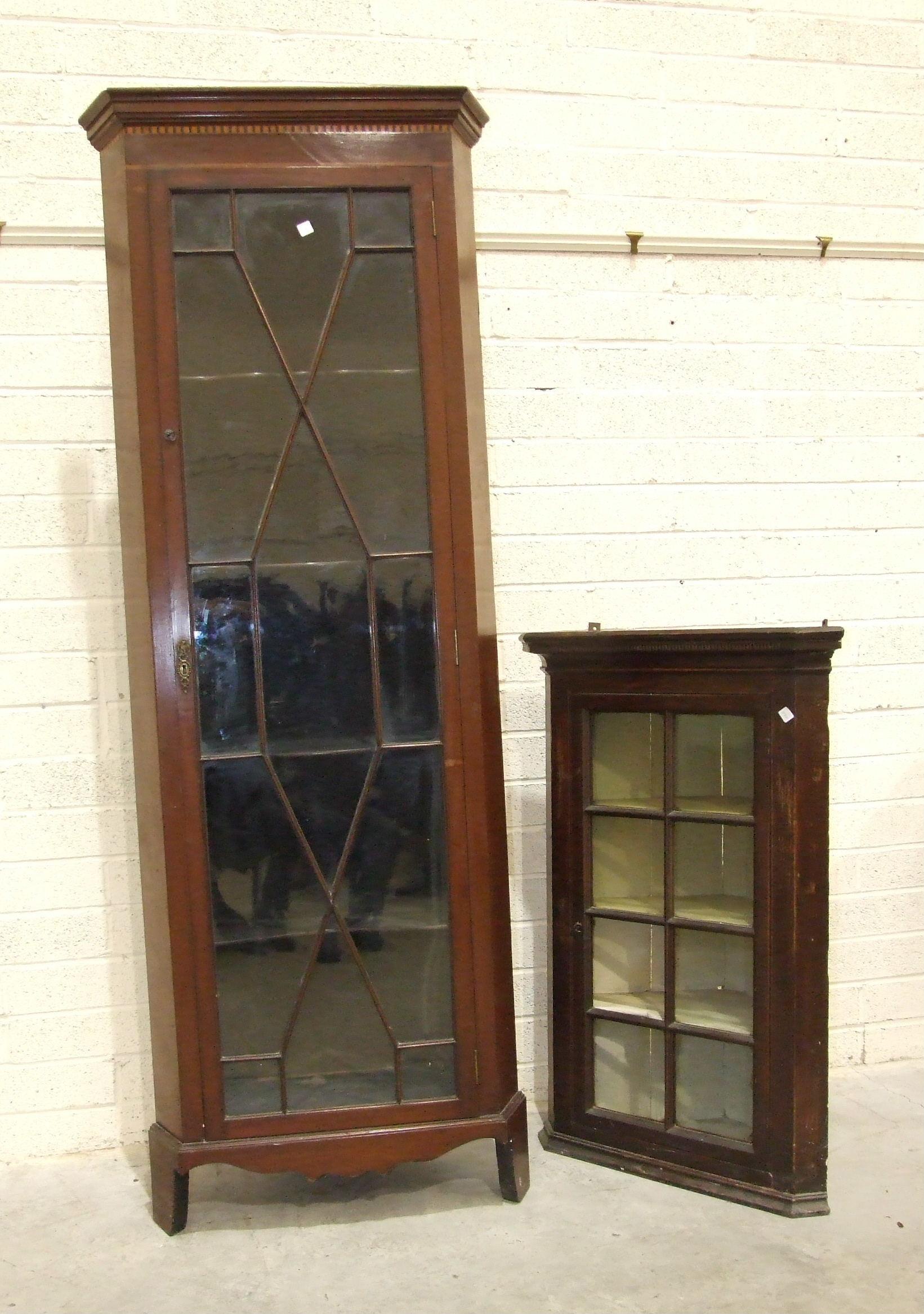 Lot 71 - An Edwardian Georgian-style mahogany tall corner cupboard, the inlaid cornice above an astragal