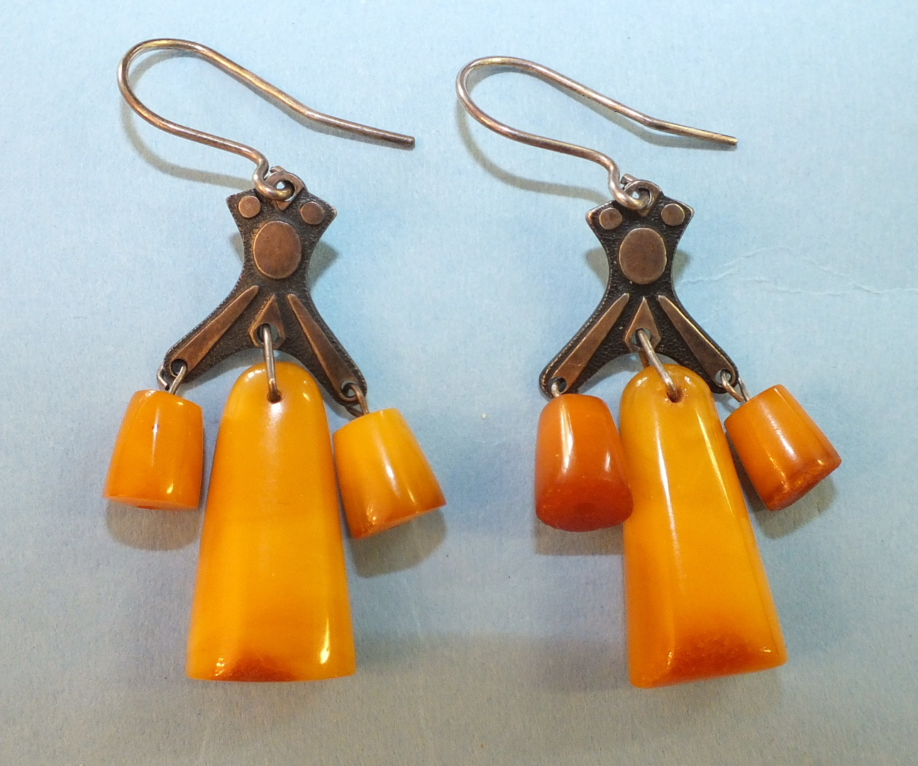 Lot 177 - A pair of Russian amber earrings, each with three amber drops below metal mount, bearing Russian 875