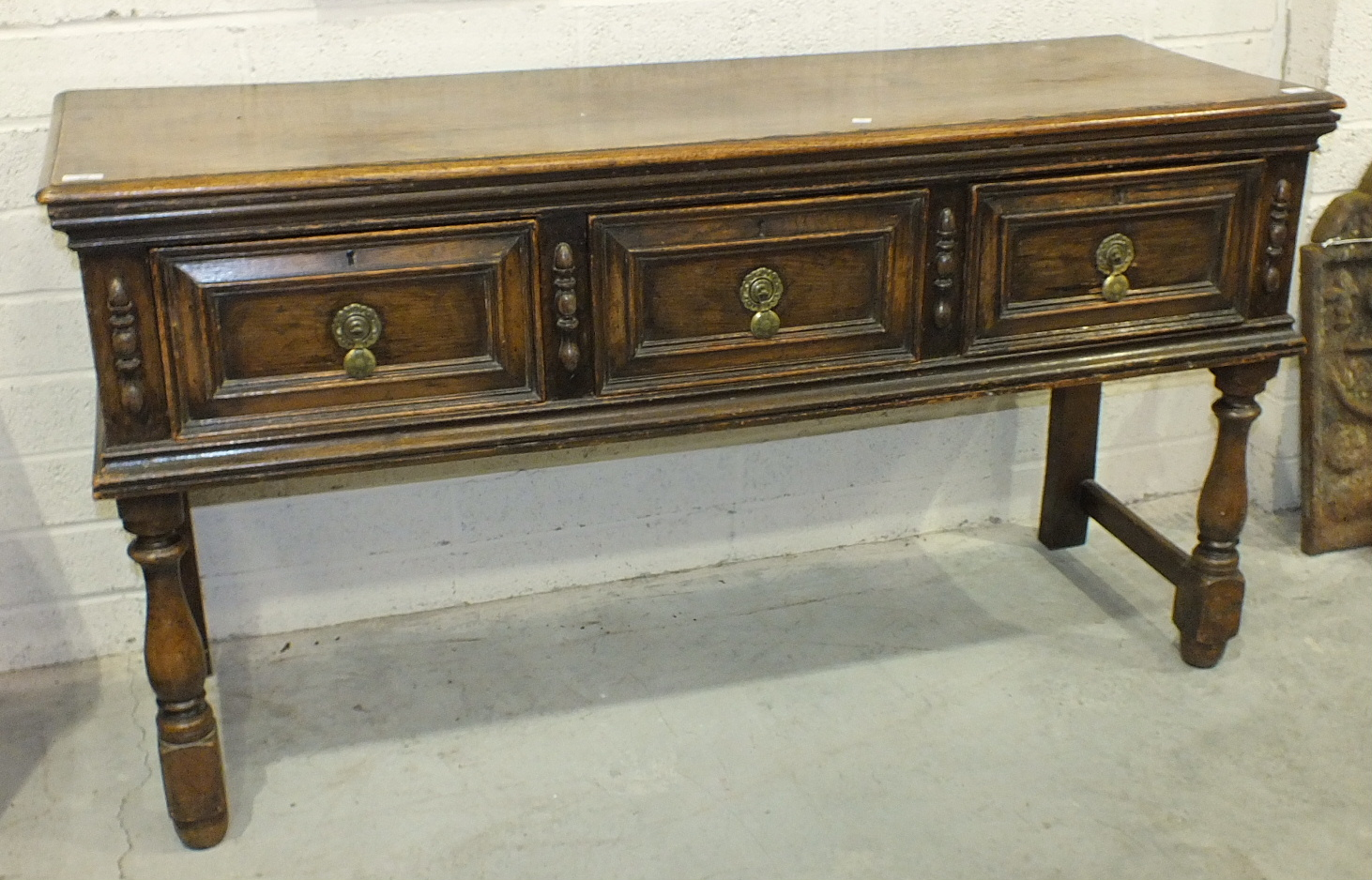Lot 59 - A late-19th/early-20th century Continental dresser base, the rectangular top with moulded edge,