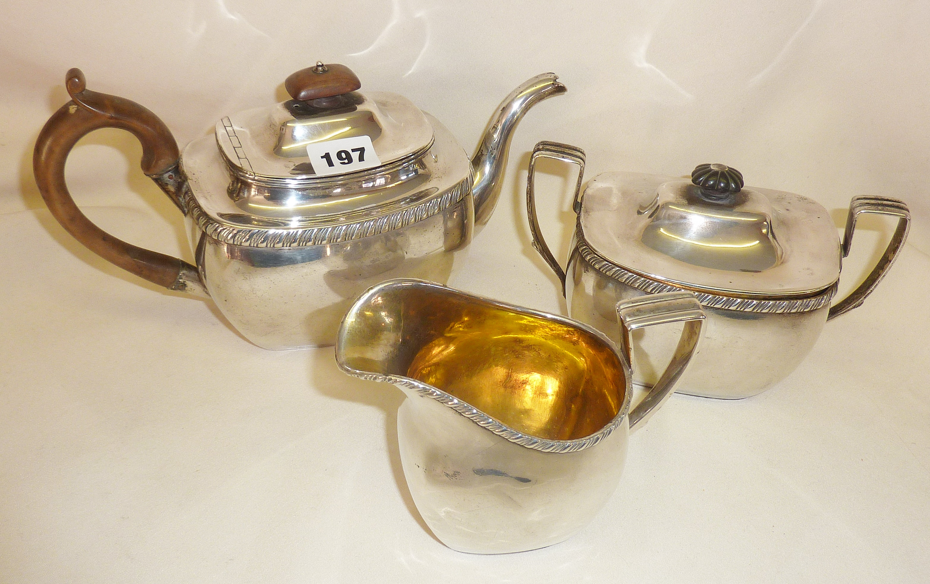 Three piece solid silver tea set with mark for St. Petersburg and engraved date of 1817 (approx