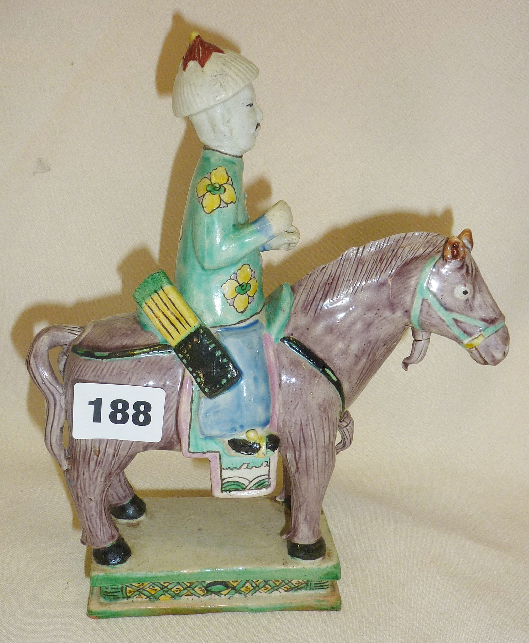 "Lot 188 - Chinese pottery polychrome figure on a horse, approx. 9"" high"