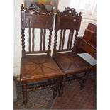 Pair of Victorian oak hall chairs with barley-twist supports above carved solid seat
