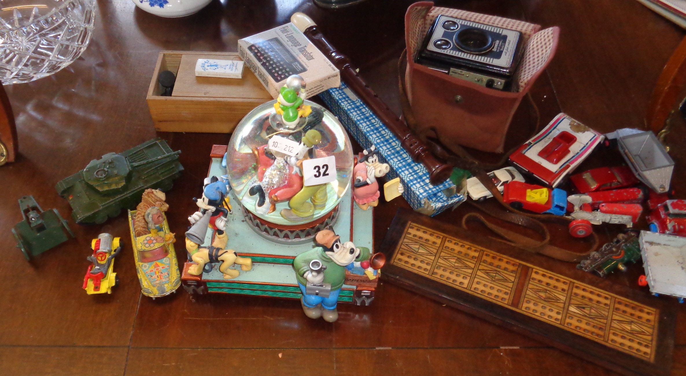 Lot 32 - Disney character musical snow globe, some diecast vehicles, a box Brownie, etc.
