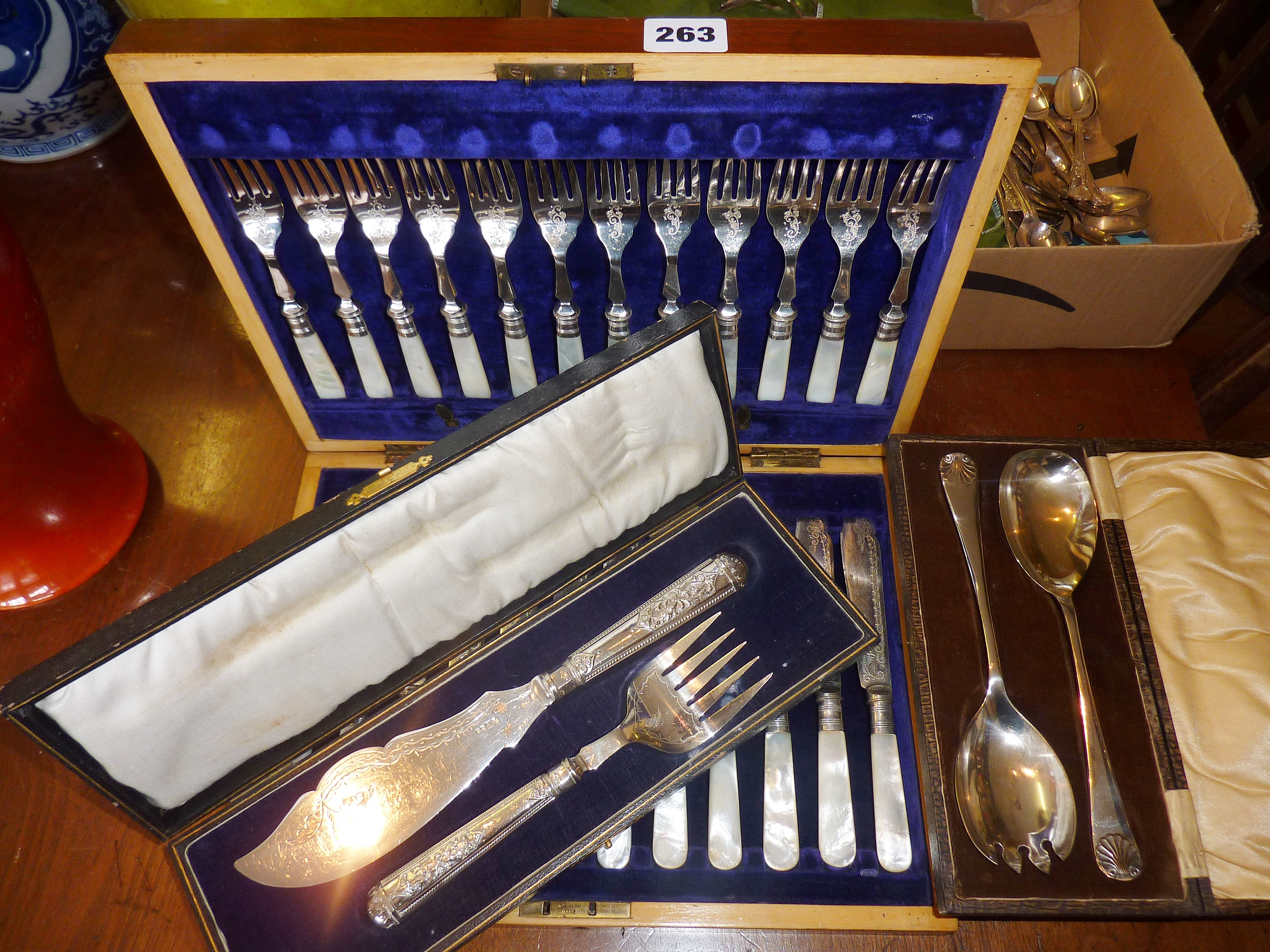 Cased set of twelve fish knives and forks, with mother-of-pearl handles, cased fish servers and