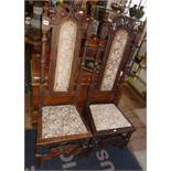 Pair of 19th century carved oak Jacobean Revival side chairs, with upholstered seats and back