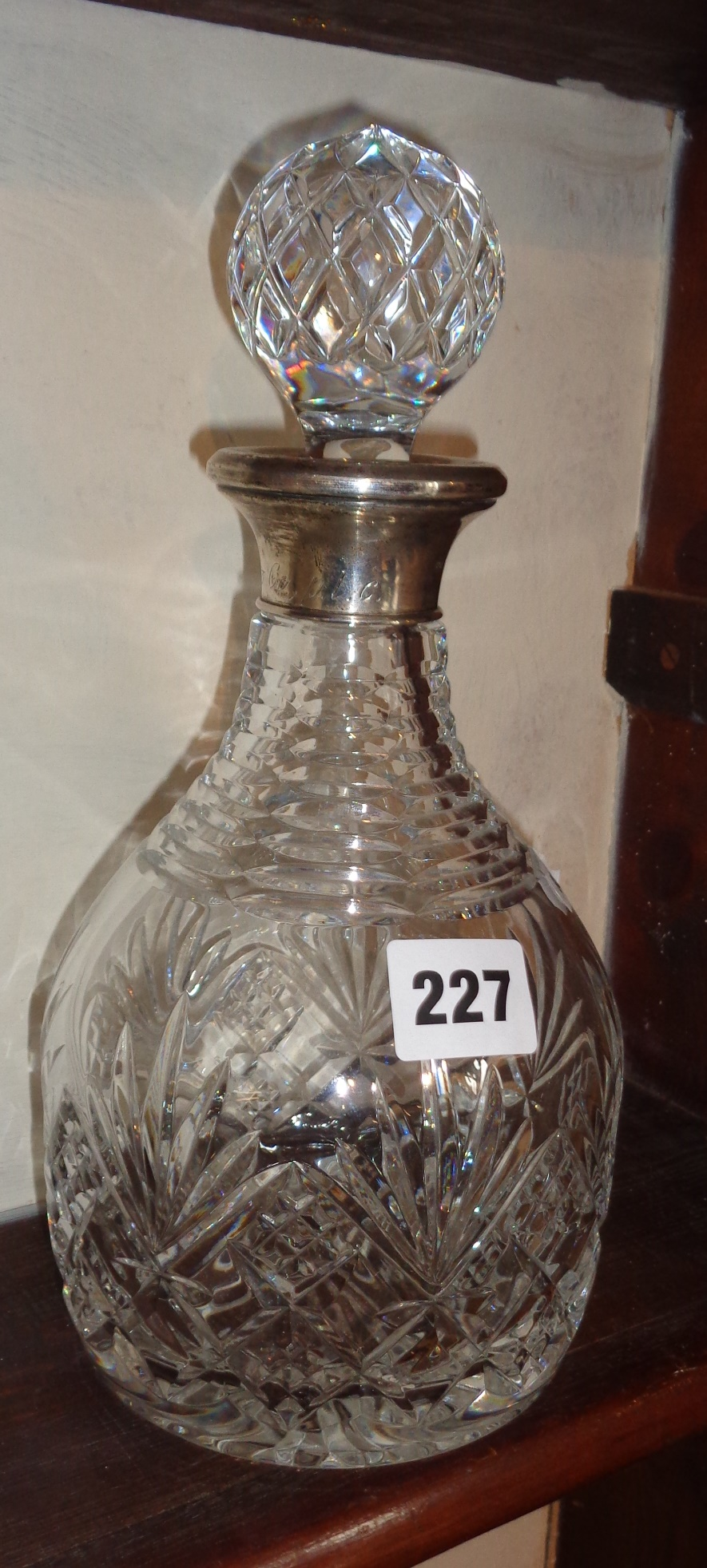 Lot 227 - Silver rimmed cut-glass decanter, c.1969 with inscription to rim 'Eldridge Pope'
