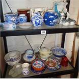 Two shelves of assorted pottery and china