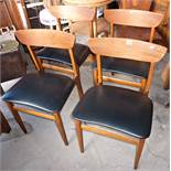Four Danish teak dining chairs with vinyl seats