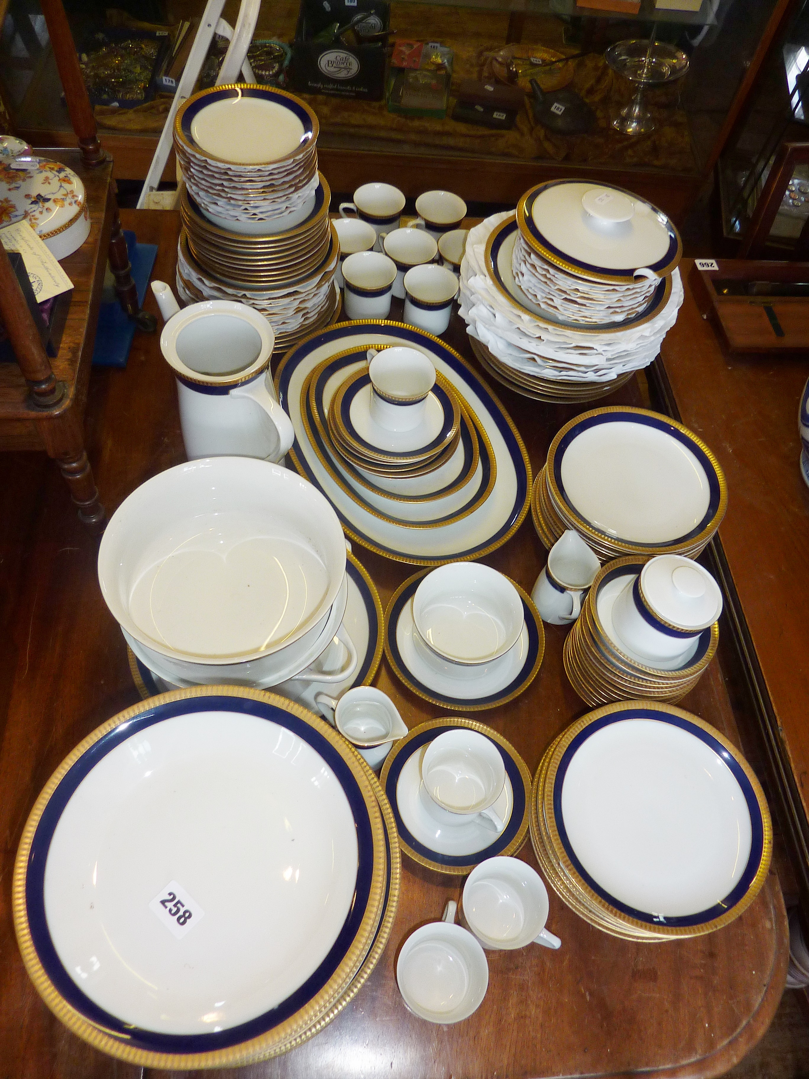 Lot 258 - Extensive Thomas of Germany Dinner and Coffee Service, in white with blue and gold border