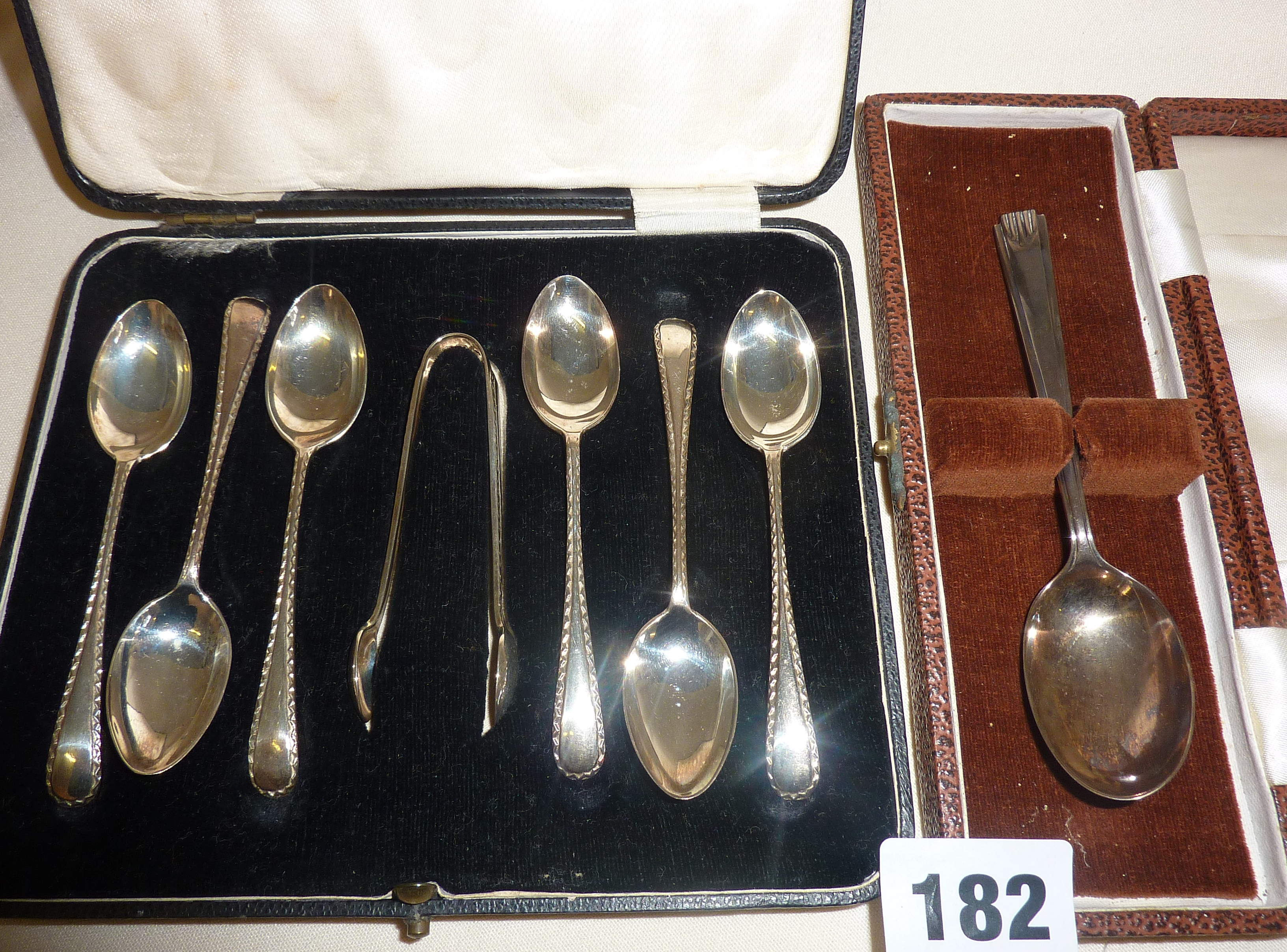 Cased hallmarked silver cutlery, set of six teaspoons and sugar tongs and an Art Deco spoon