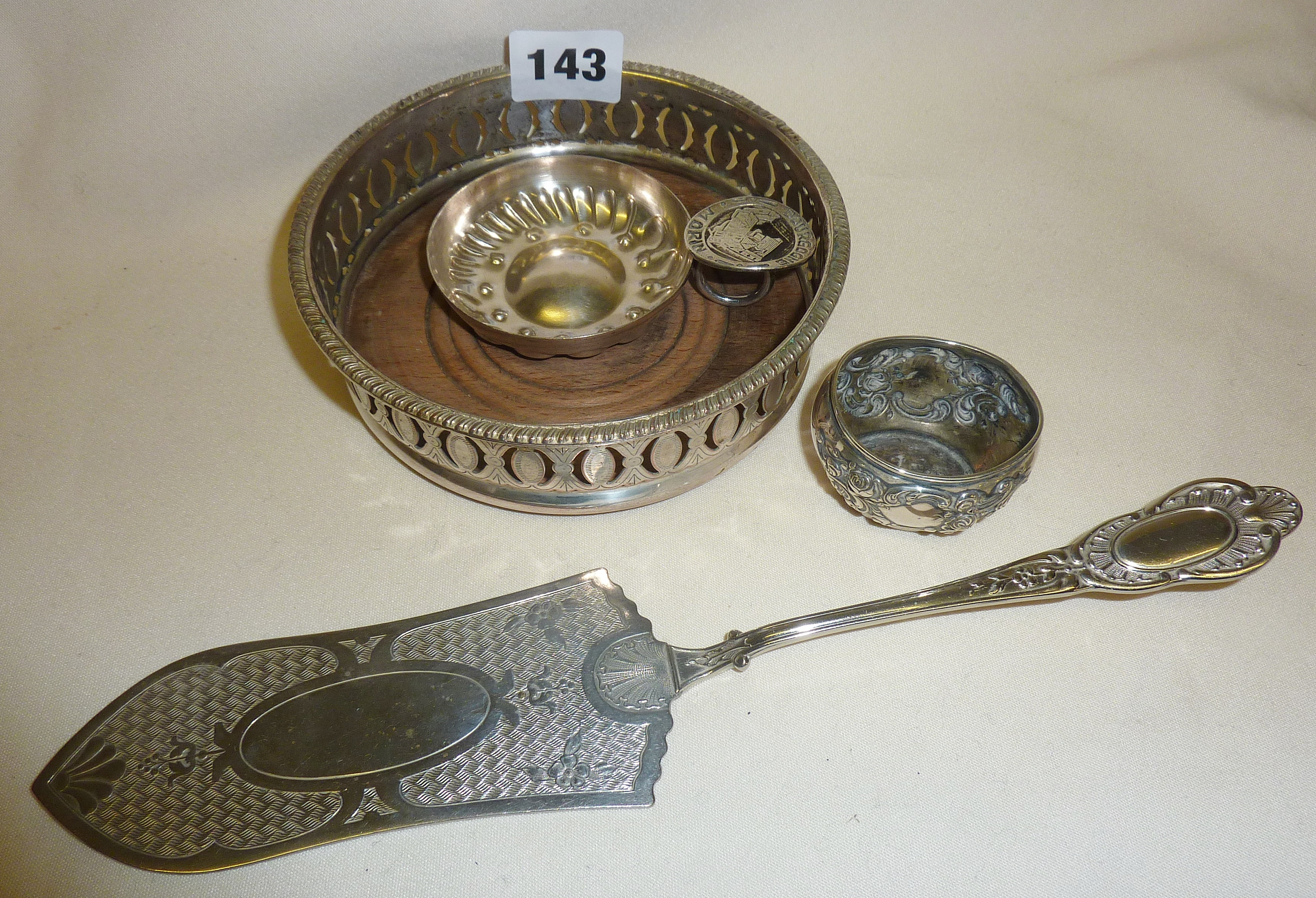 Silver plated wine taster, coaster and cake slice with a hallmarked silver salt pot