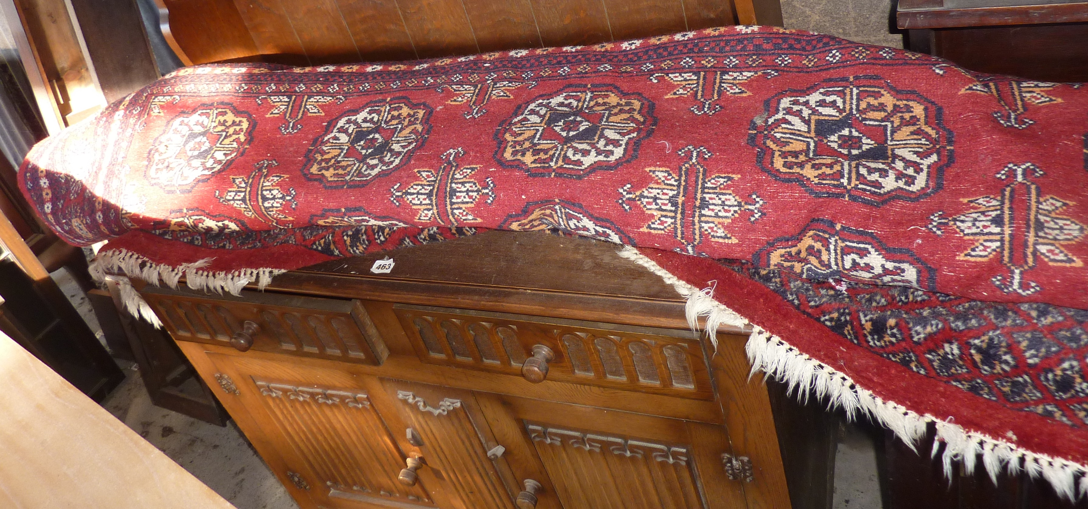 Large Persian style carpet/rug on red ground, approx. 8' x 12'