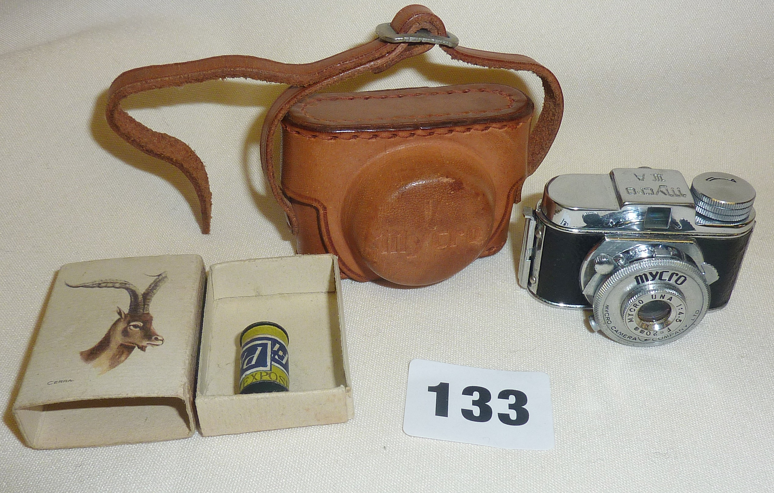 Lot 133 - Mycro Una vintage miniature camera in leather case with film roll