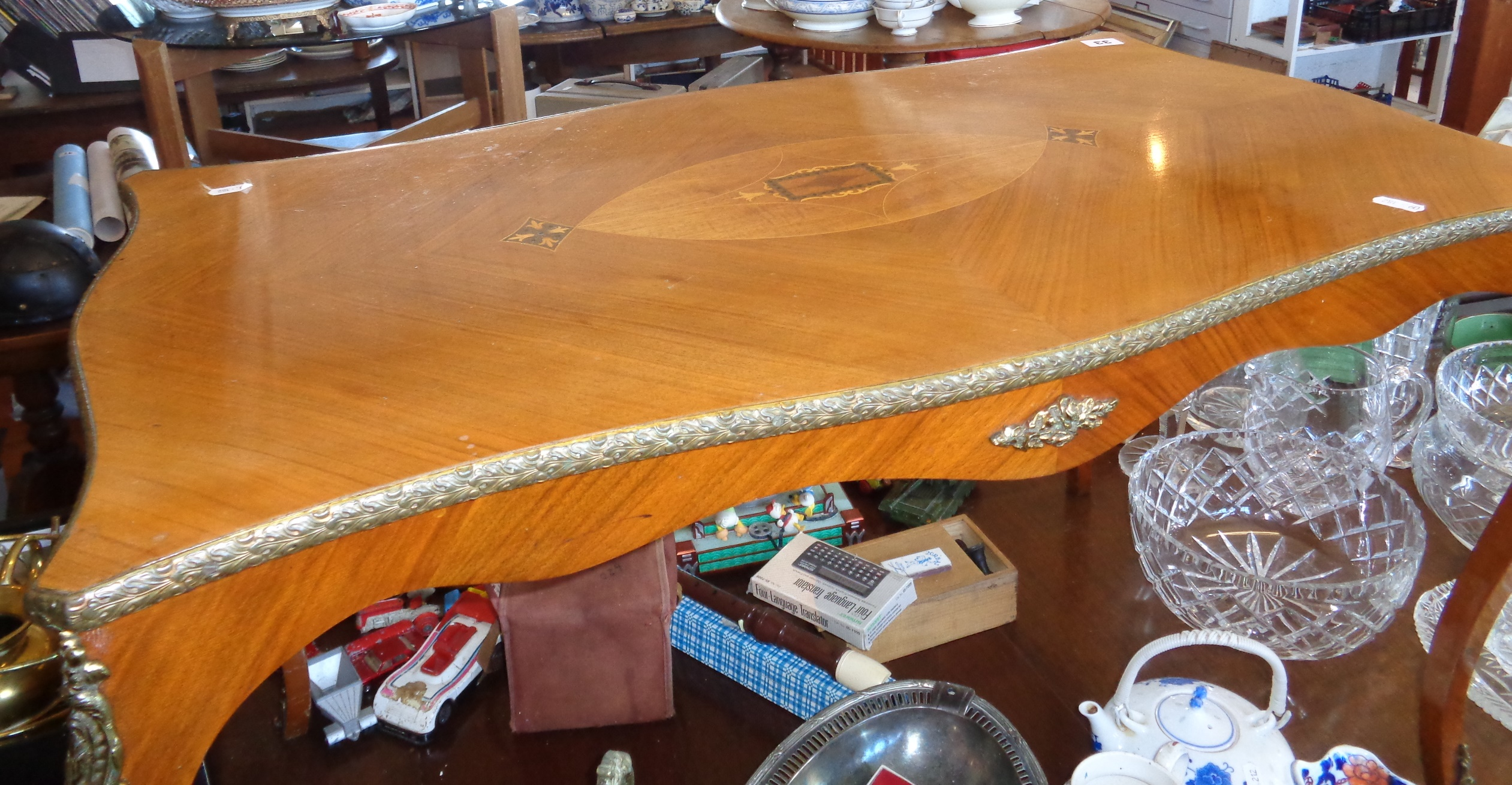 Lot 33 - French inlaid coffee table on cabriole legs with ormulu mounts