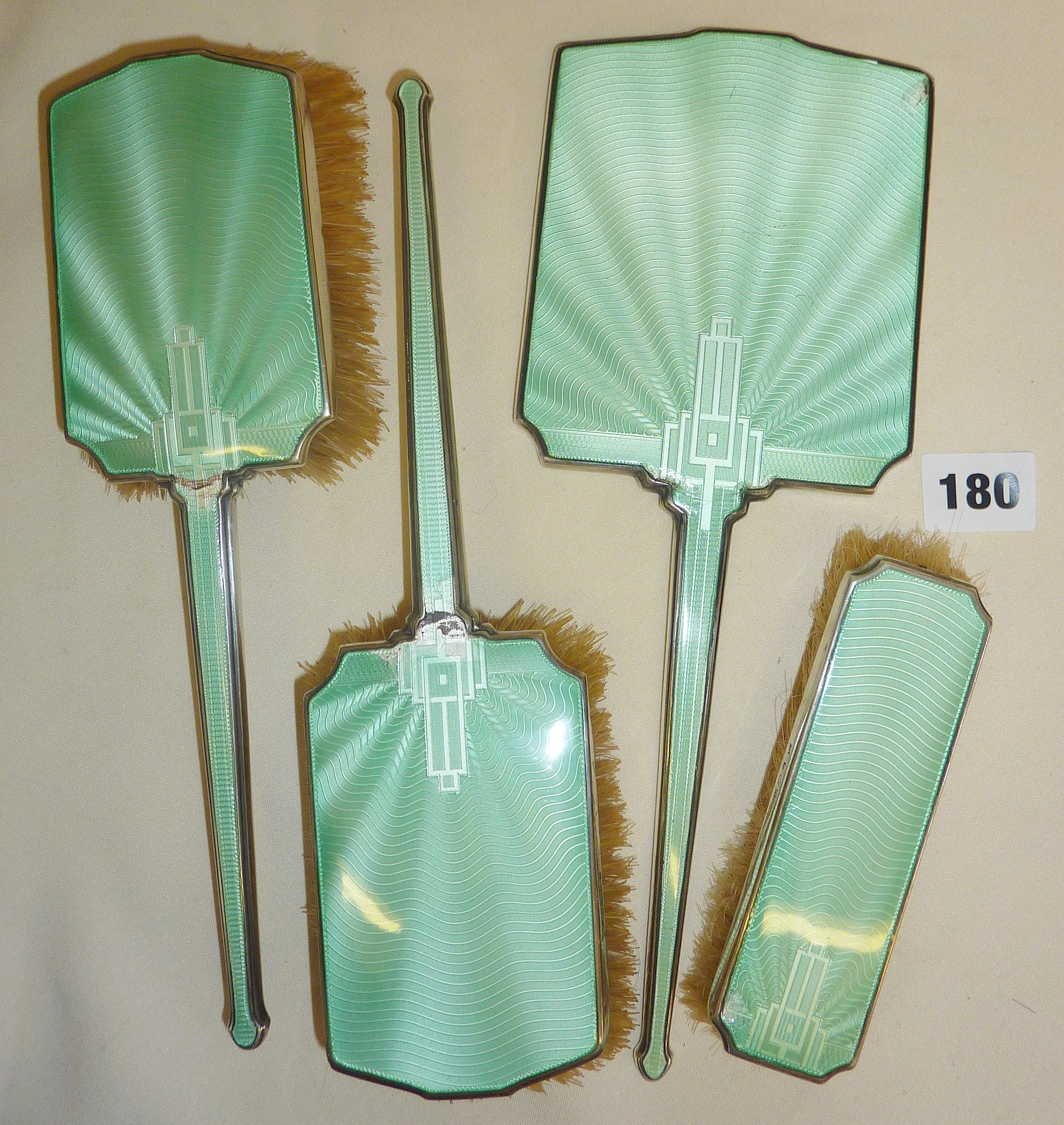 Four piece Art Deco guilloche enamel vanity set of brushes and mirror, retailed by Goldsmiths &