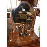 19th century shield-shaped mahogany dressing table mirror on bowfronted base with three drawers