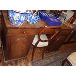 Victorian mahogany kneehole desk of three drawers above two doors