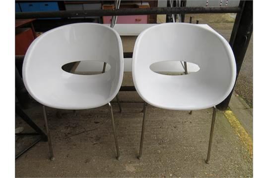 A 2006 pair of Sintesi plastic tub chairs