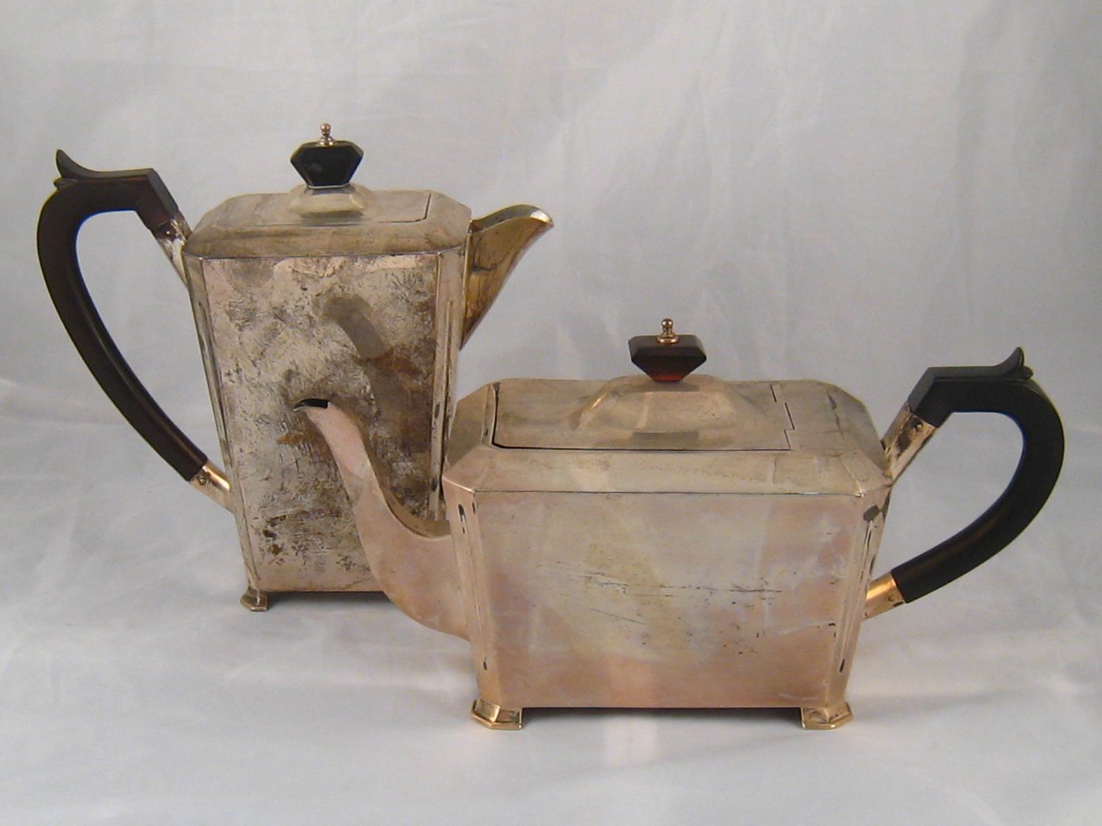 Lot 216 - An Art Deco silver teapot and water jug, each on four feet with box hinge lid,  S Blankensee & Sons,
