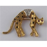 A 9 carat gold brooch designed as a cat and set with rubies, sapphires and diamonds, approx 4cm, 4.
