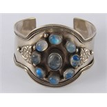 A white metal (tests silver) moonstone cuff bracelet, approx 5cm wide, 59 gms.